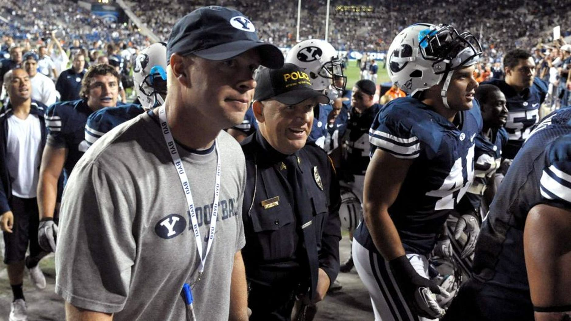 Sep 23, 2011; Provo, UT, USA; BYU Cougars coach Bronco Mendenhall walks off the field after the game against the UCF Knights at LaVell Edwards Stadium. BYU defeated UCF 24-17. Mandatory Credit: Kirby Lee/Image of Sport-USA TODAY Sports