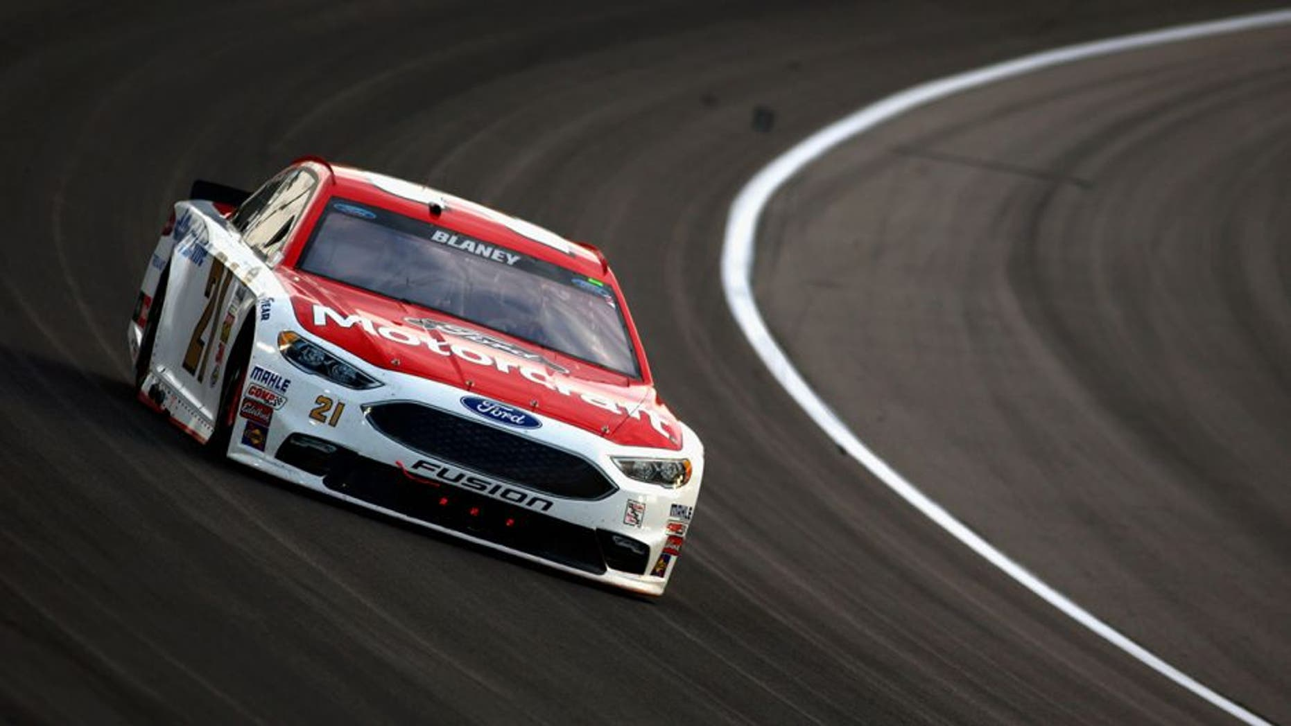 KANSAS CITY, KS - MAY 07: Ryan Blaney, driver of the #21 Motorcraft/Quick Lane Tire & Auto Center Ford, races during the NASCAR Sprint Cup Series Go Bowling 400 at Kansas Speedway on May 7, 2016 in Kansas City, Kansas. (Photo by Jamie Squire/Getty Images)