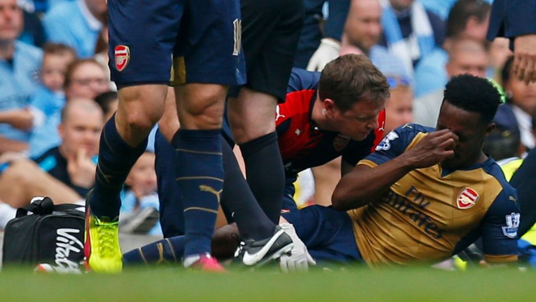 """Britain Soccer Football - Manchester City v Arsenal - Barclays Premier League - Etihad Stadium - 8/5/16 Arsenal's Danny Welbeck receives treatment after sustaining an injury before being substituted Action Images via Reuters / Jason Cairnduff Livepic EDITORIAL USE ONLY. No use with unauthorized audio, video, data, fixture lists, club/league logos or """"live"""" services. Online in-match use limited to 45 images, no video emulation. No use in betting, games or single club/league/player publications. Please contact your account representative for further details."""