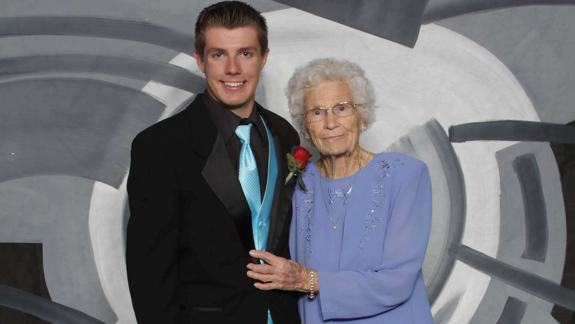 This photo provided by Inter-State Studio & Publishing Co. Shows Drew Holm and his great-grandmother Kathryn Keith in their prom picture.