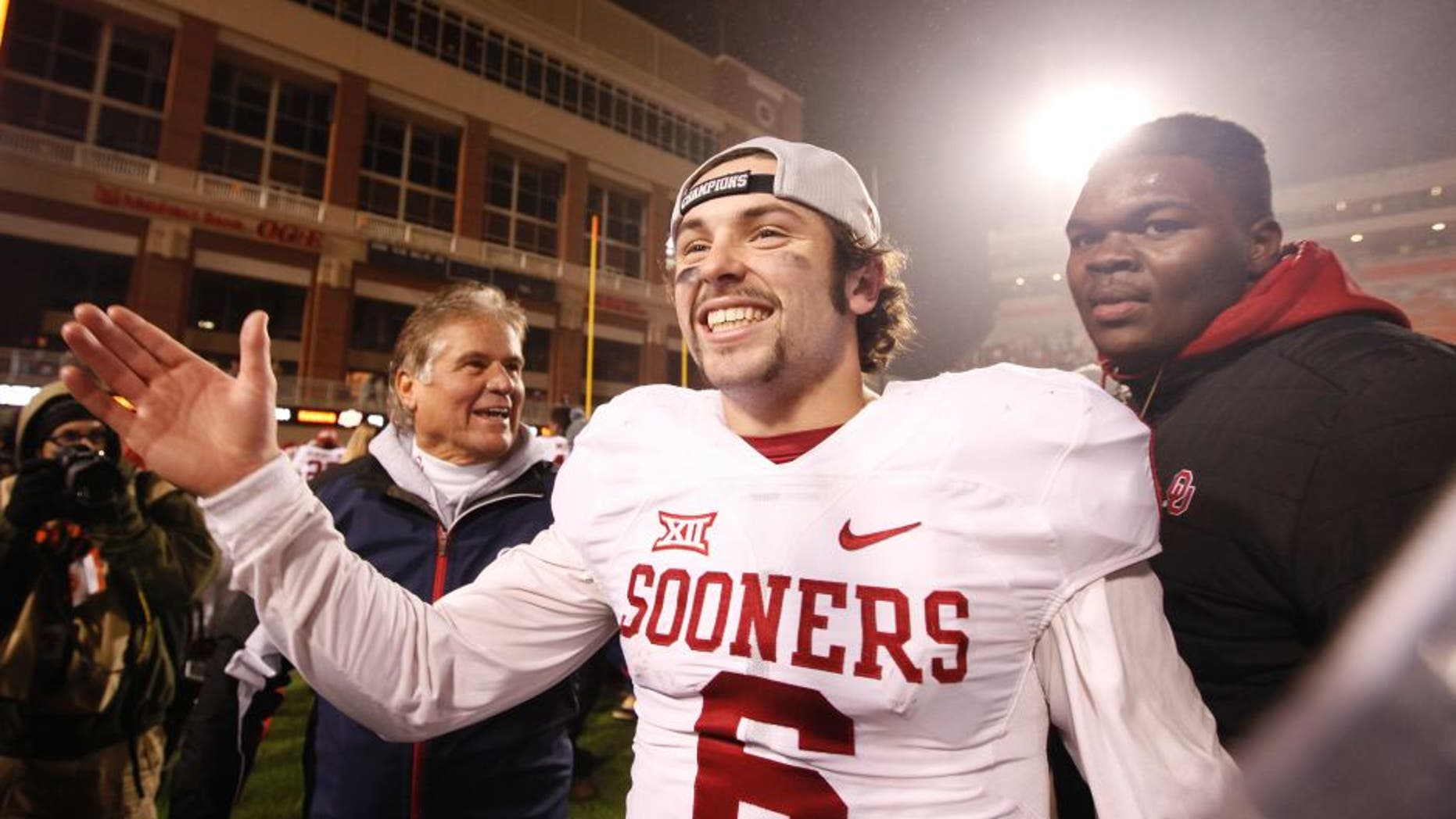 STILLWATER, OK - NOVEMBER 28 : Quarterback Baker Mayfield #6 of the Oklahoma Sooners celebrates after the game against the Oklahoma State Cowboys November 28, 2015 at Boone Pickens Stadium in Stillwater, Oklahoma. Oklahoma defeated Oklahoma State 58-23.(Photo by Brett Deering/Getty Images)