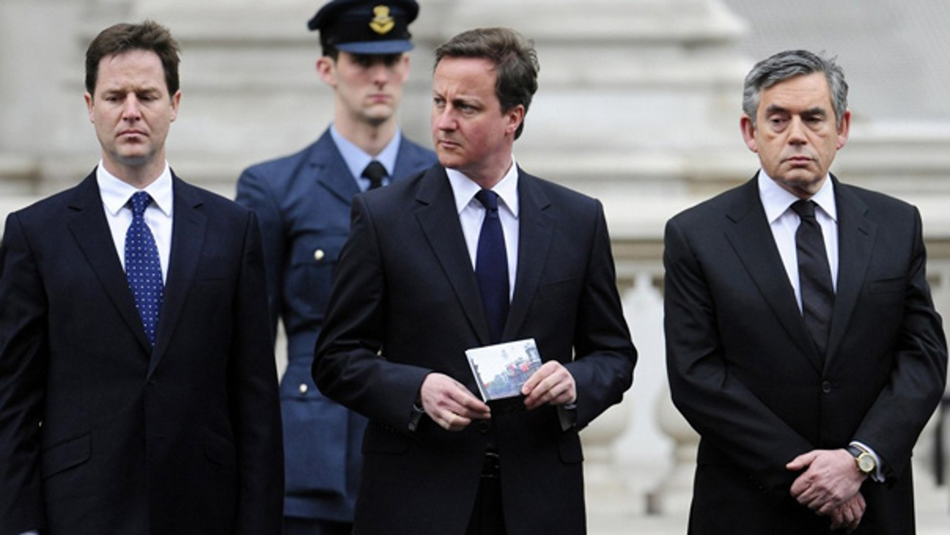 May 8: Britain's Prime Minister Gordon Brown, right, stands with Conservative Party leader David Cameron, center, and Liberal Democrat leader Nick Clegg, left, during a Victory in Europe day ceremony in London.