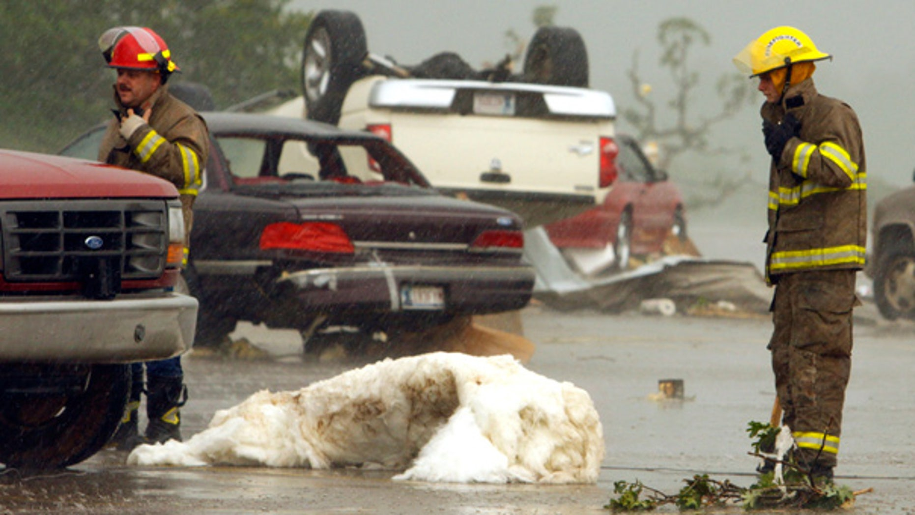 May 10: Overturned cars and debris litter the street after a violent storm tore through Norman, Okla.