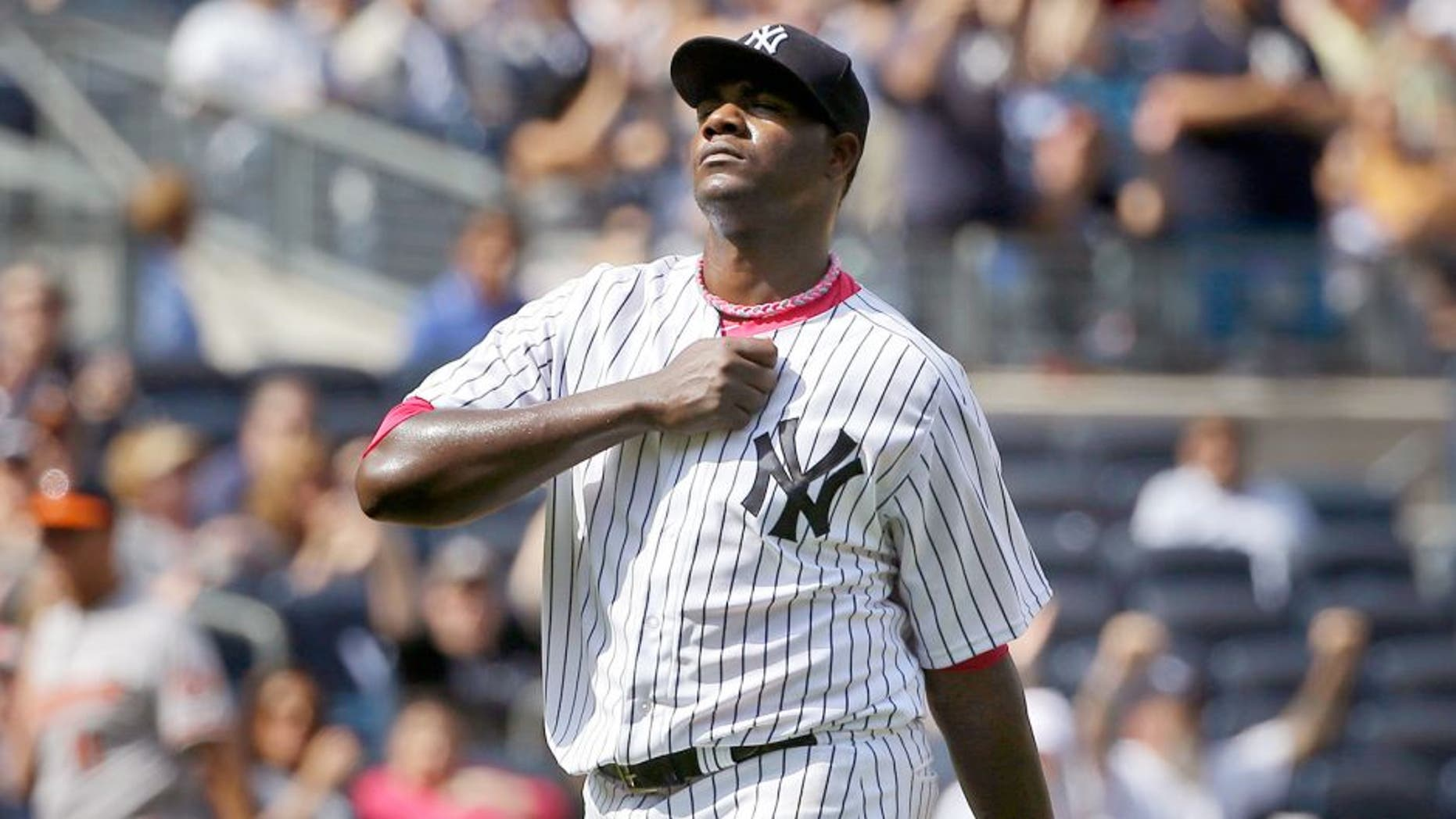 New York Yankees starting pitcher Michael Pineda reacts after striking out Baltimore Orioles' Ryan Flaherty during the seventh inning of the baseball game at Yankee Stadium, Sunday, May 10, 2015, in New York. (AP Photo/Seth Wenig)