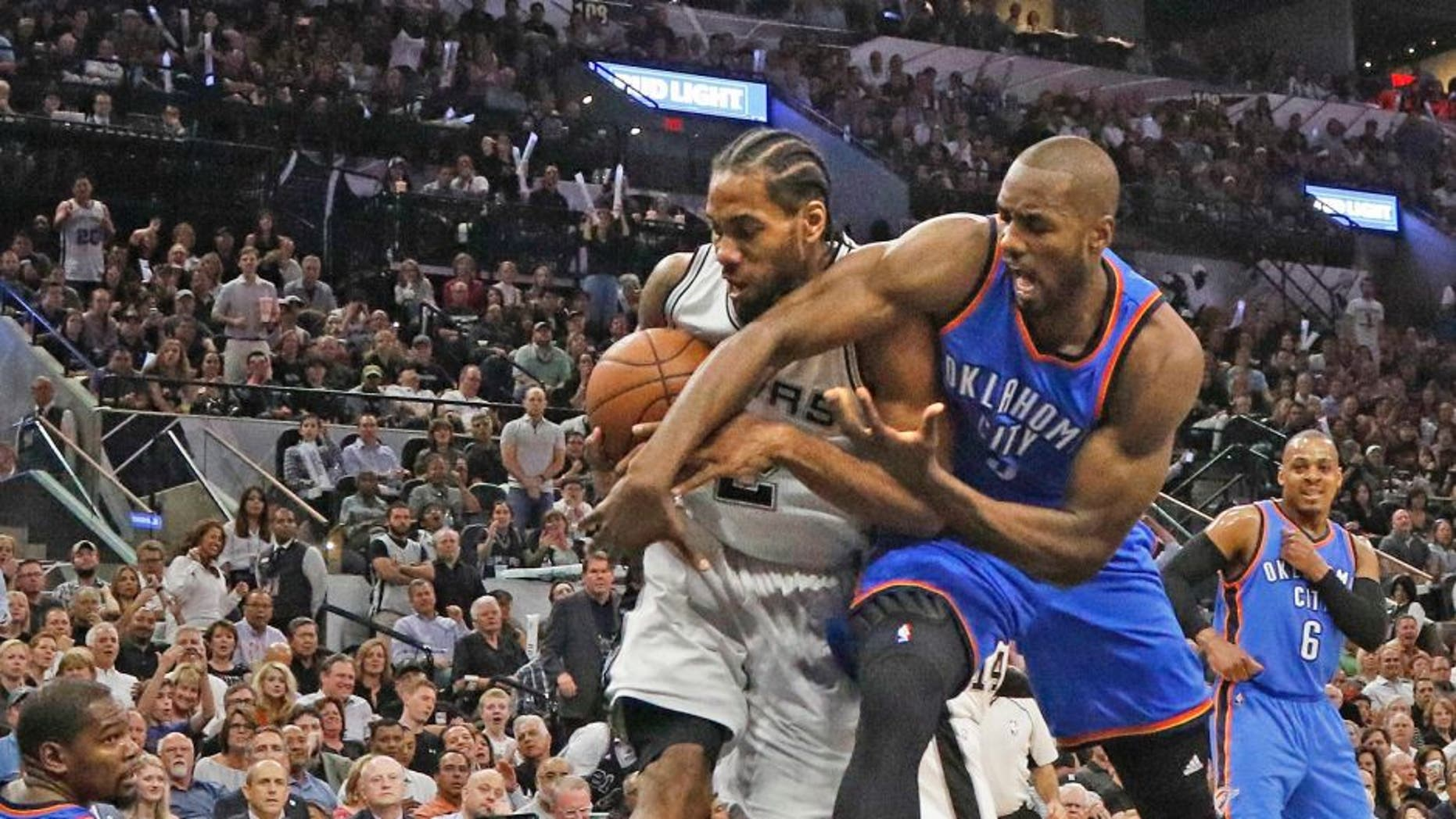 SAN ANTONIO, TX - MAY 10: Kawhi Leonard #2 of the San Antonio Spurs steals the ball away from Serge Ibaka #9 of the Oklahoma City Thunder in game Five of the Western Conference Semifinals during the 2016 NBA Playoffs at AT&T Center on May 10, 2016 in San Antonio, Texas. NOTE TO USER: User expressly acknowledges and agrees that , by downloading and or using this photograph, User is consenting to the terms and conditions of the Getty Images License Agreement. (Photo by Ronald Cortes/Getty Images)