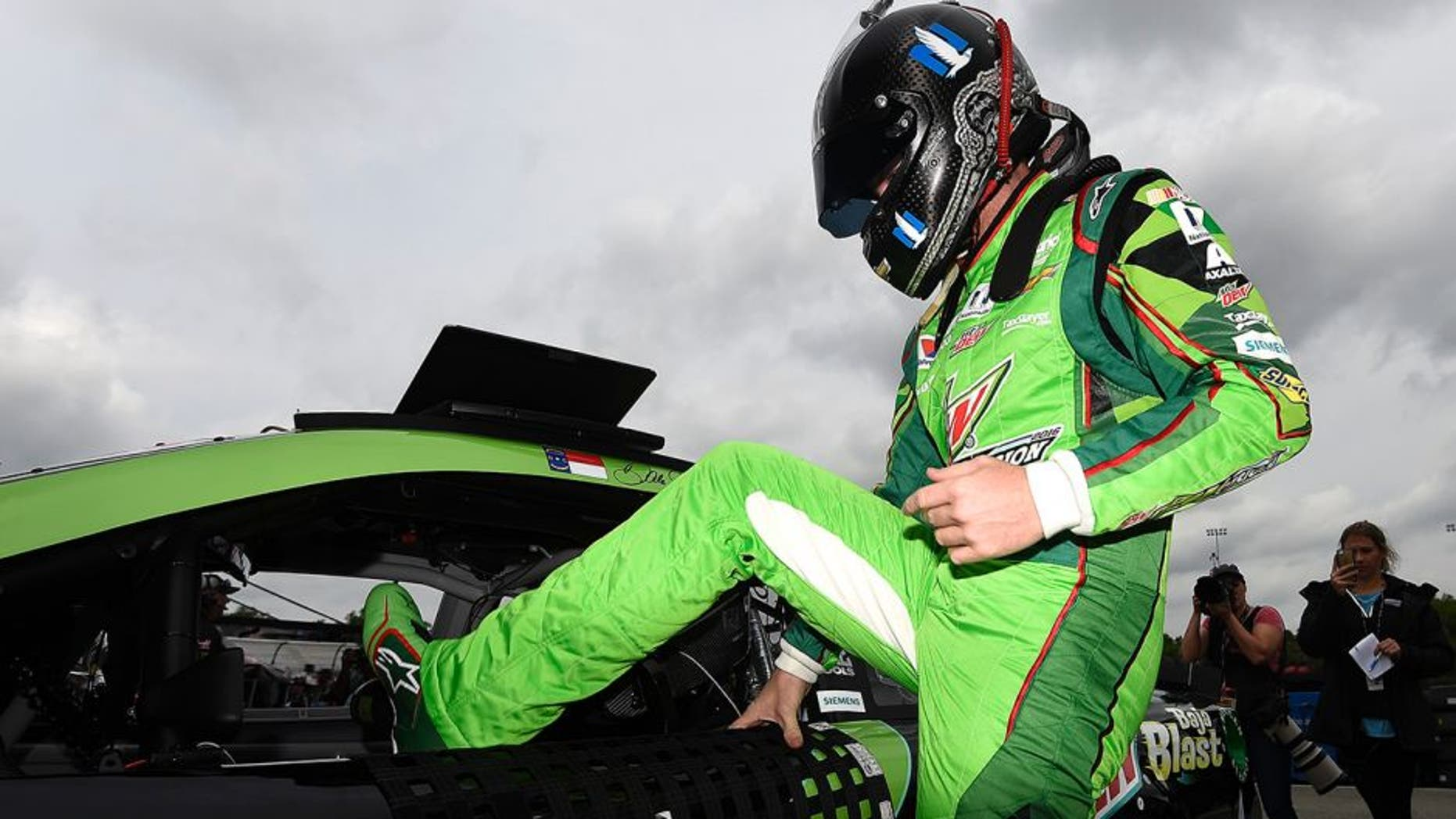 RICHMOND, VA - APRIL 22: Dale Earnhardt Jr., driver of the #88 Mountain Dew Chevrolet, climbs into his car during practice for the NASCAR Sprint Cup Series TOYOTA OWNERS 400 at Richmond International Raceway on April 22, 2016 in Richmond, Virginia. (Photo by Rainier Ehrhardt/Getty Images)