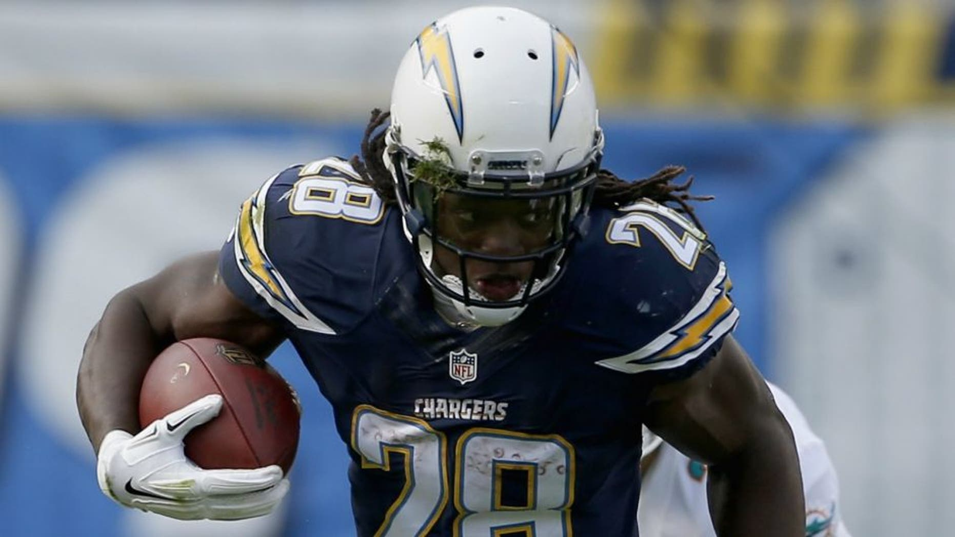 at Qualcomm Stadium on December 20, 2015 in San Diego, California.,SAN DIEGO, CA - DECEMBER 20: Melvin Gordon #28 of the San Diego Chargers runs against Bobby McCain #28 of the Miami Dolphins at Qualcomm Stadium on December 20, 2015 in San Diego, California. (Photo by Todd Warshaw/Getty Images)