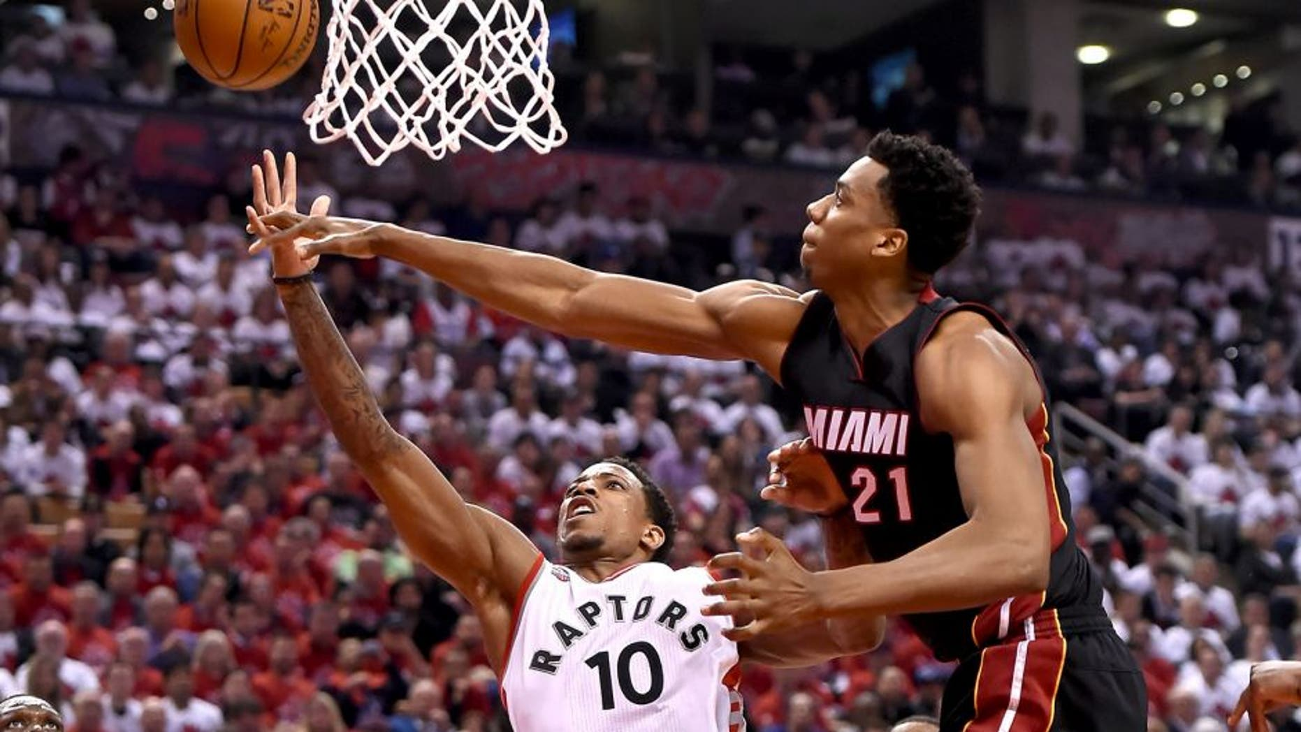 May 3, 2016; Toronto, Ontario, CAN; Toronto Raptors guard DeMar DeRozan (10) has a shot blocked by Miami Heat center Hassan Whiteside (21) in game one of the second round of the NBA Playoffs at Air Canada Centre. The Heat won 102-96. Mandatory Credit: Dan Hamilton-USA TODAY Sports