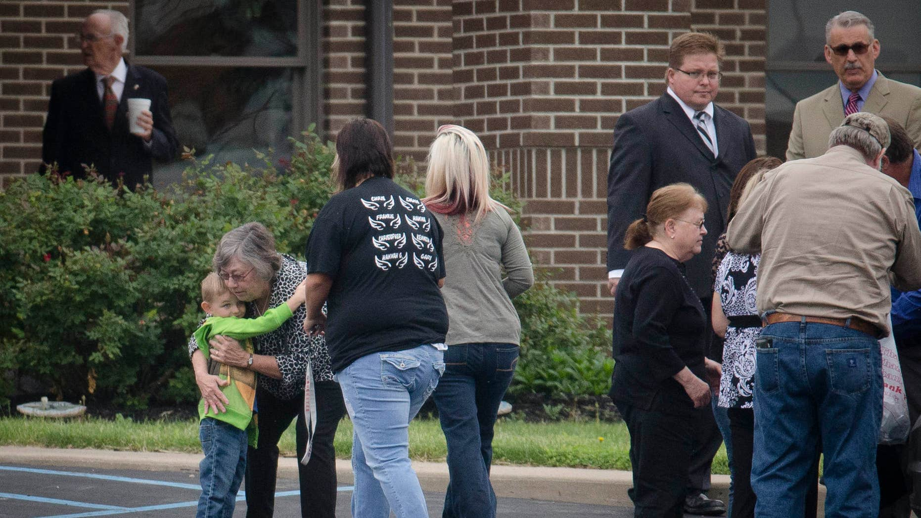 Mourners arrive at Dry Run Church of Christ for funeral services for six of the eight murder victims from Pike County, Tuesday, May 3, 2016, in West Portsmouth, Ohio.