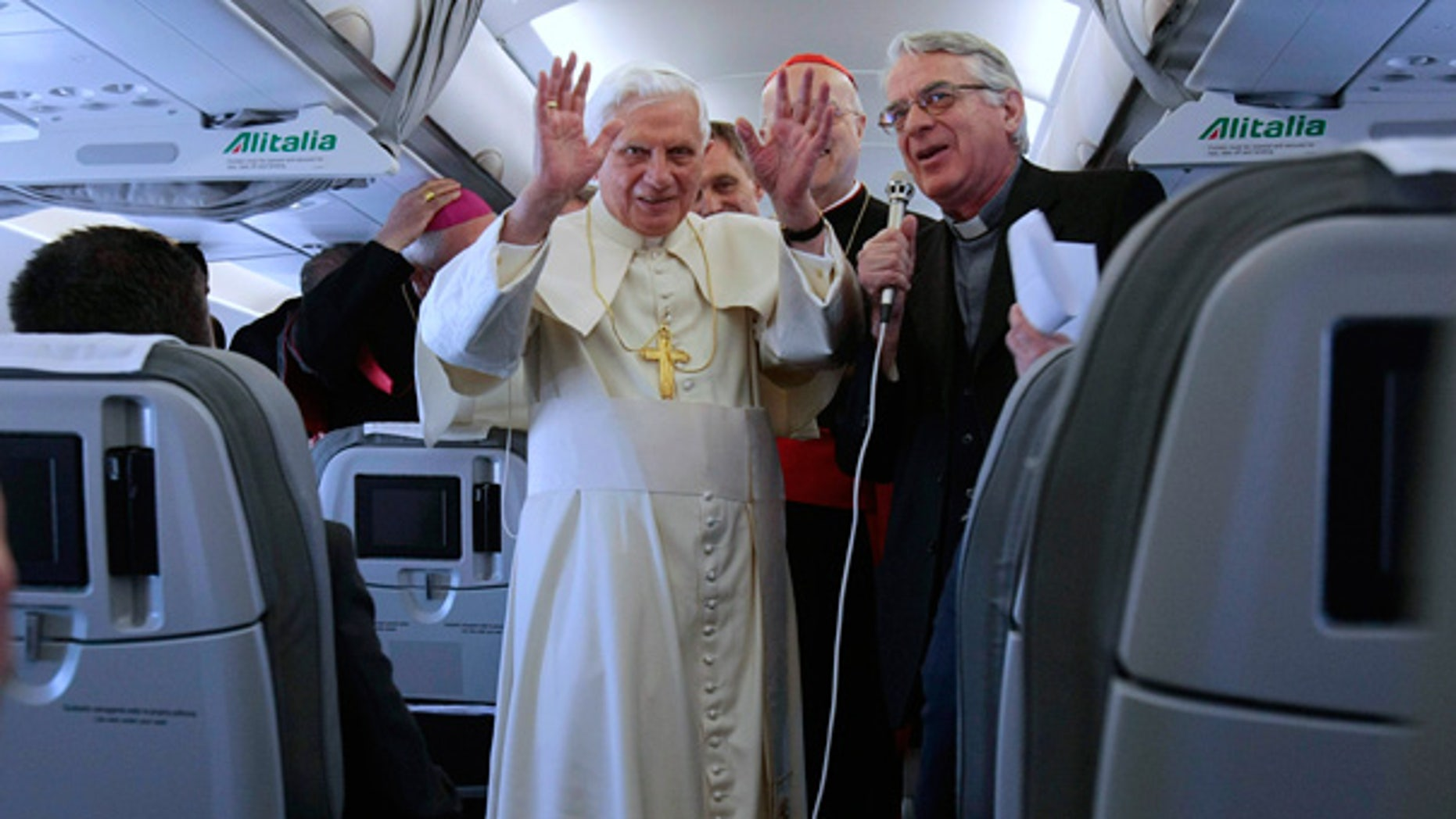 May 11: Pope Benedict XVI, left, flanked by Vatican spokesperson Father Federico Lombardi, aboard a plane enroute to Lisbon, Portugal.