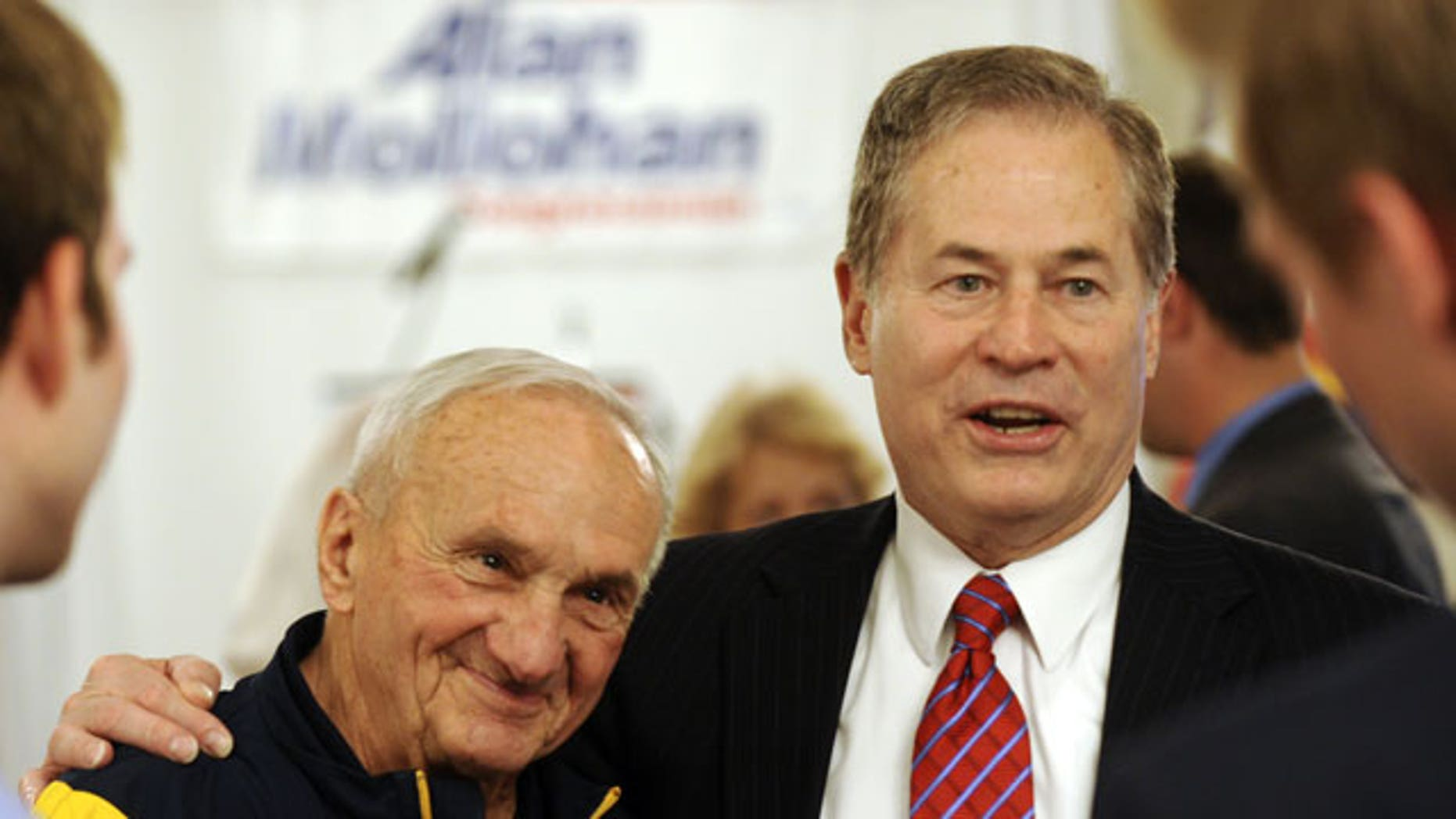 """May 11: West Virginia 2nd Congressional District Congressman Alan Mollohan, right, gives a hug to long-time supporter John """"Sheriff"""" Tiano, inside Mollohan's campaign headquarters in Morgantown, W.Va."""