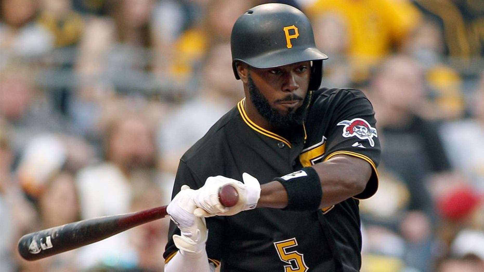 PITTSBURGH, PA - APRIL 18: Josh Harrison #5 of the Pittsburgh Pirates bats during the game against the Milwaukee Brewers at PNC Park on April 18, 2015 in Pittsburgh, Pennsylvania. (Photo by Justin K. Aller/Getty Images)
