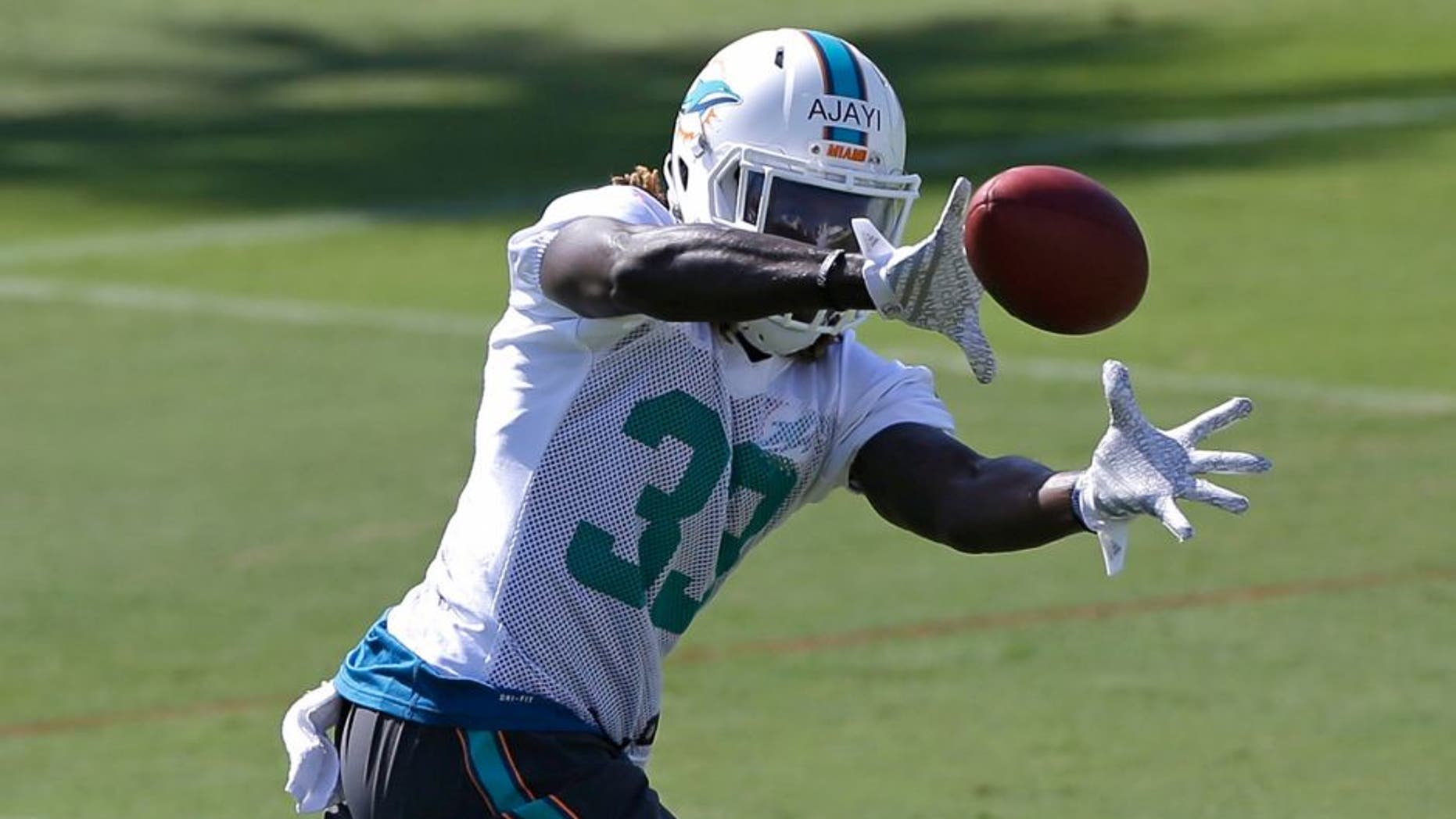 Miami Dolphins rookie Jay Ajayi prepares to catch a pass during NFL football rookie minicamp, Saturday, May 9, 2015, in Davie, Fla. (AP Photo/Alan Diaz)