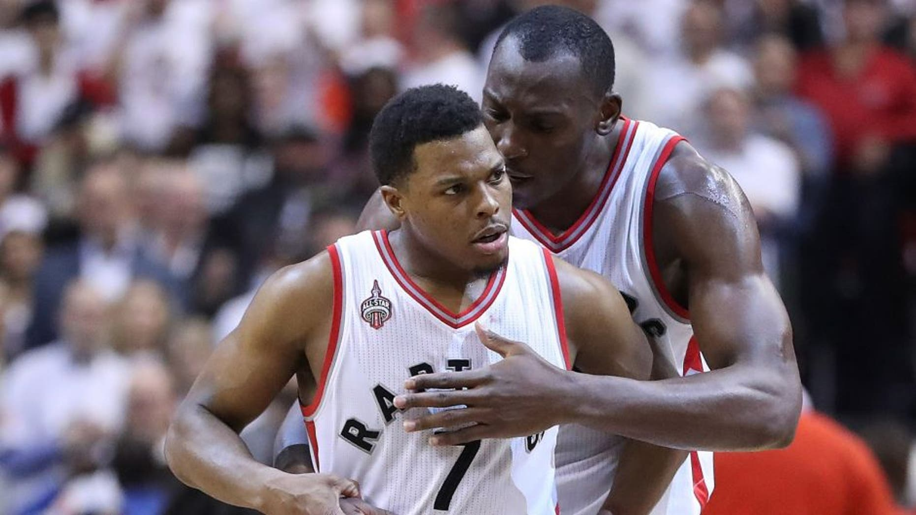 TORONTO, ON- MAY 11: Bismack Biyombo congratulates Kyle Lowry after he hit a key basket late in the game as the Toronto Raptors beat the Miami Heat in game five 99-91 of their Eastern Conference Semifinal at the Air Canada Centre in Toronto. May 11, 2016. (Steve Russell/Toronto Star via Getty Images)