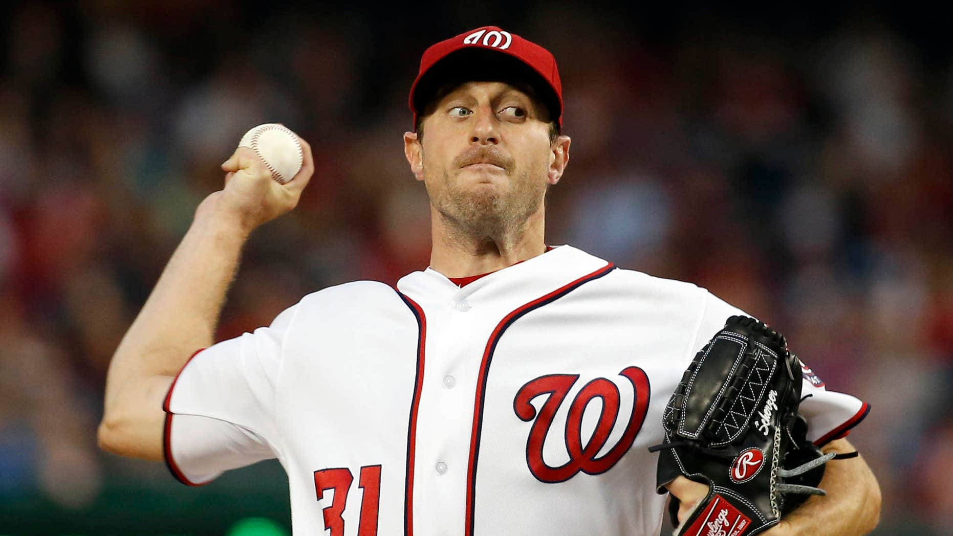 Washington Nationals starting pitcher Max Scherzer throws during the third inning of a baseball game against the Detroit Tigers at Nationals Park, Wednesday, May 11, 2016, in Washington.