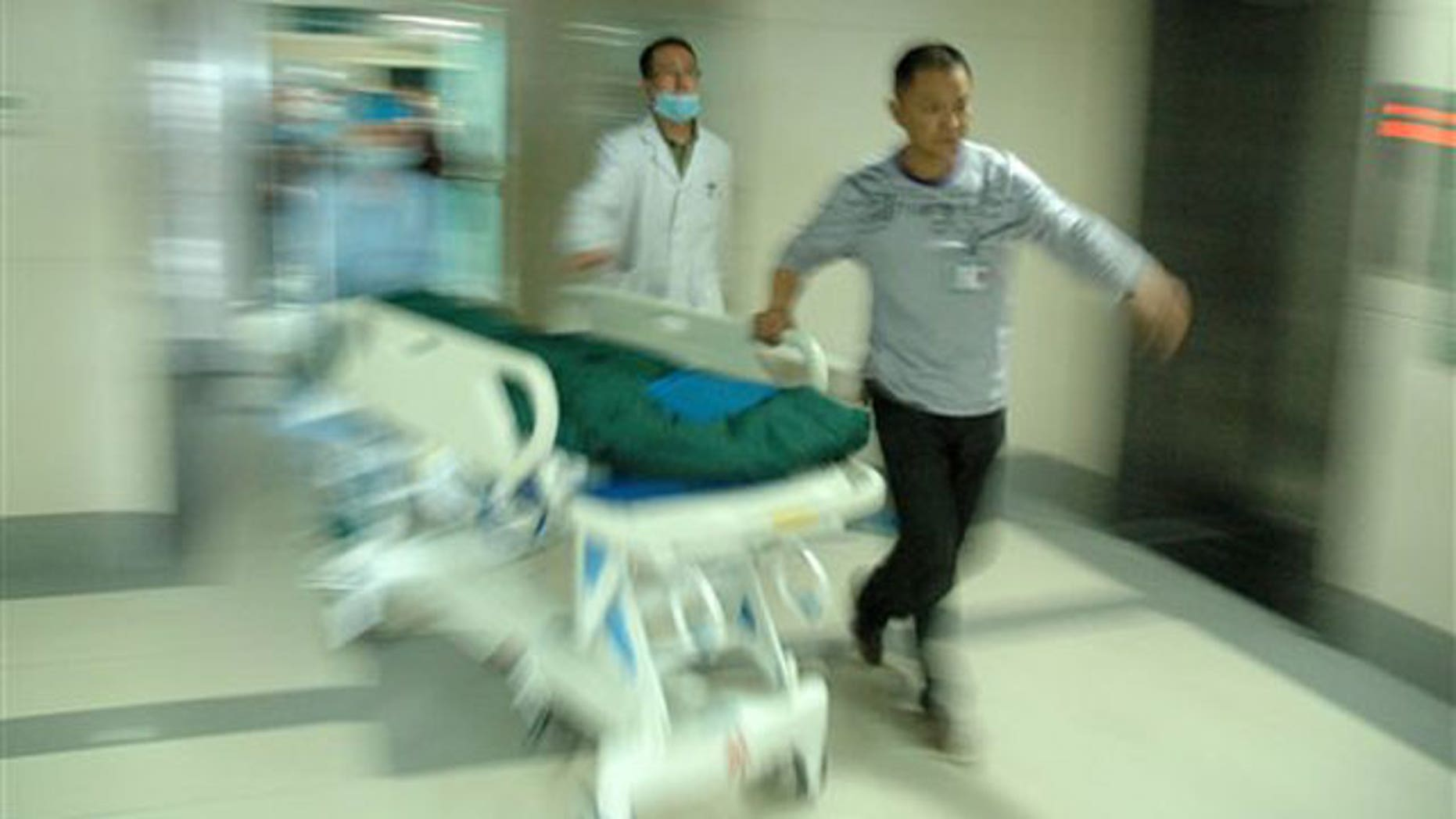 May 12: medical workers take an injured child to ICU at 3201 Hospital in Hanzhong City, northwest China's Shaanxi Province.