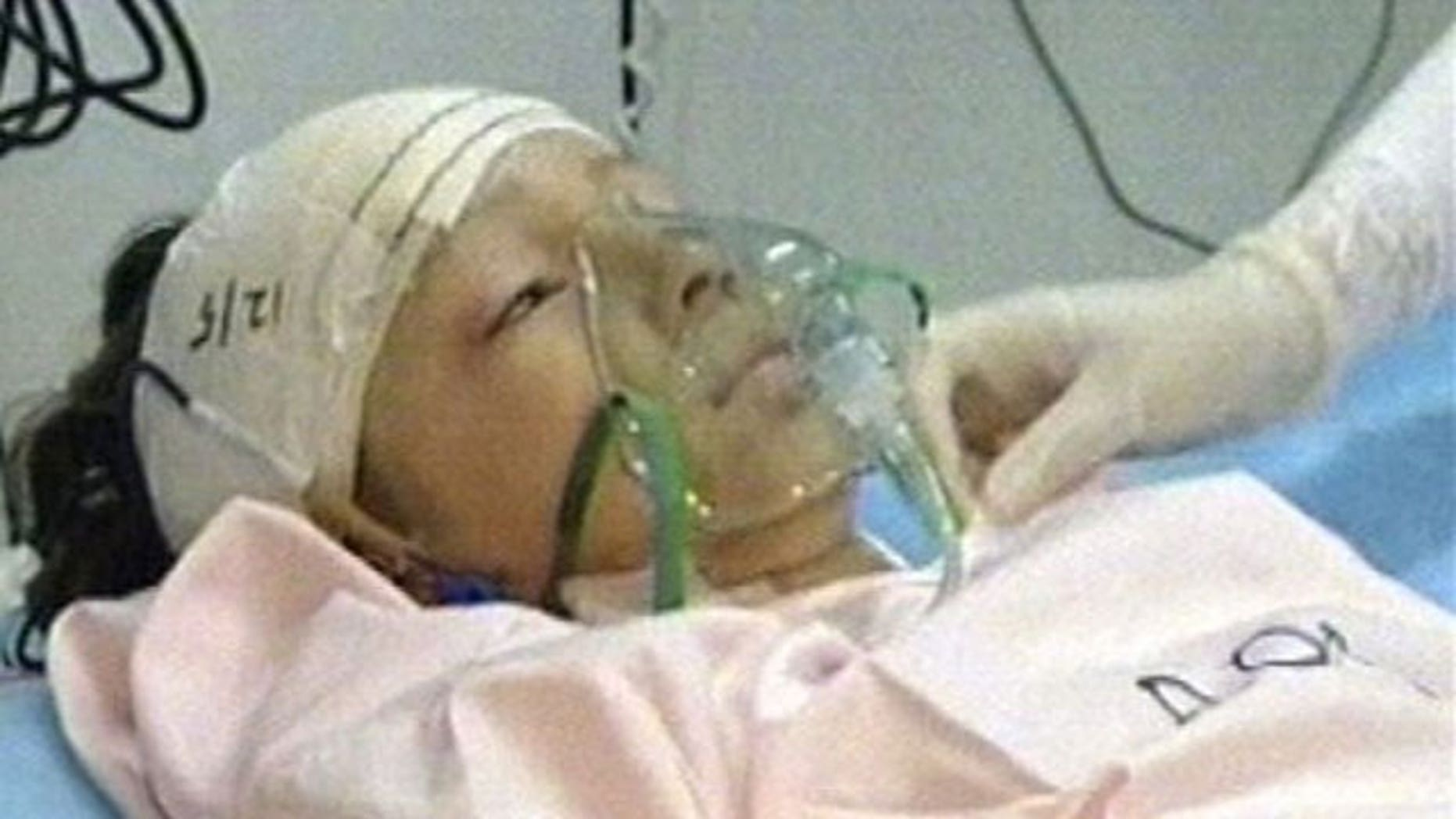In a photo released by Libya TV, the lone survivor of a Afriqiyah Airways plane crash in Tripoli is seen being treated.