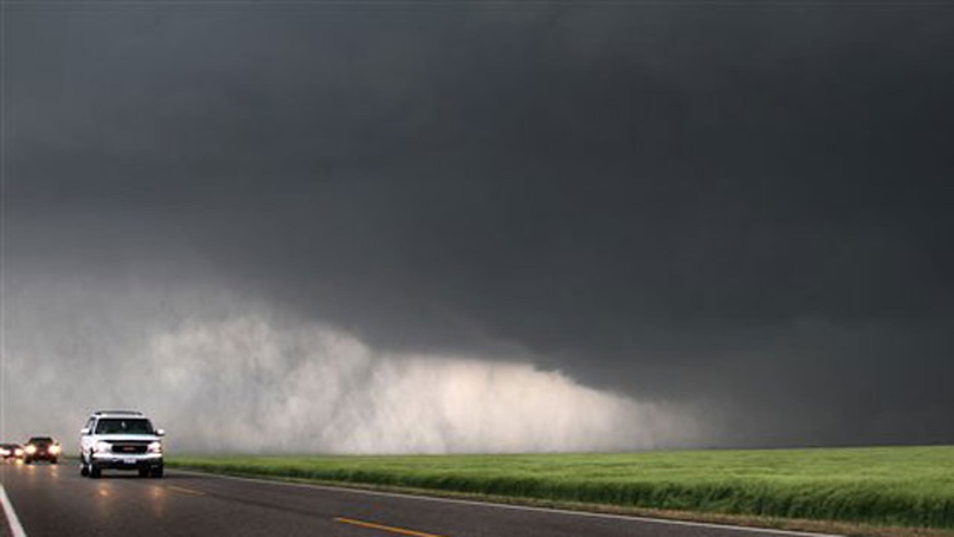 May 10: a super cell storm gains strength as it moves Northeast six miles from Wakita, Okla.