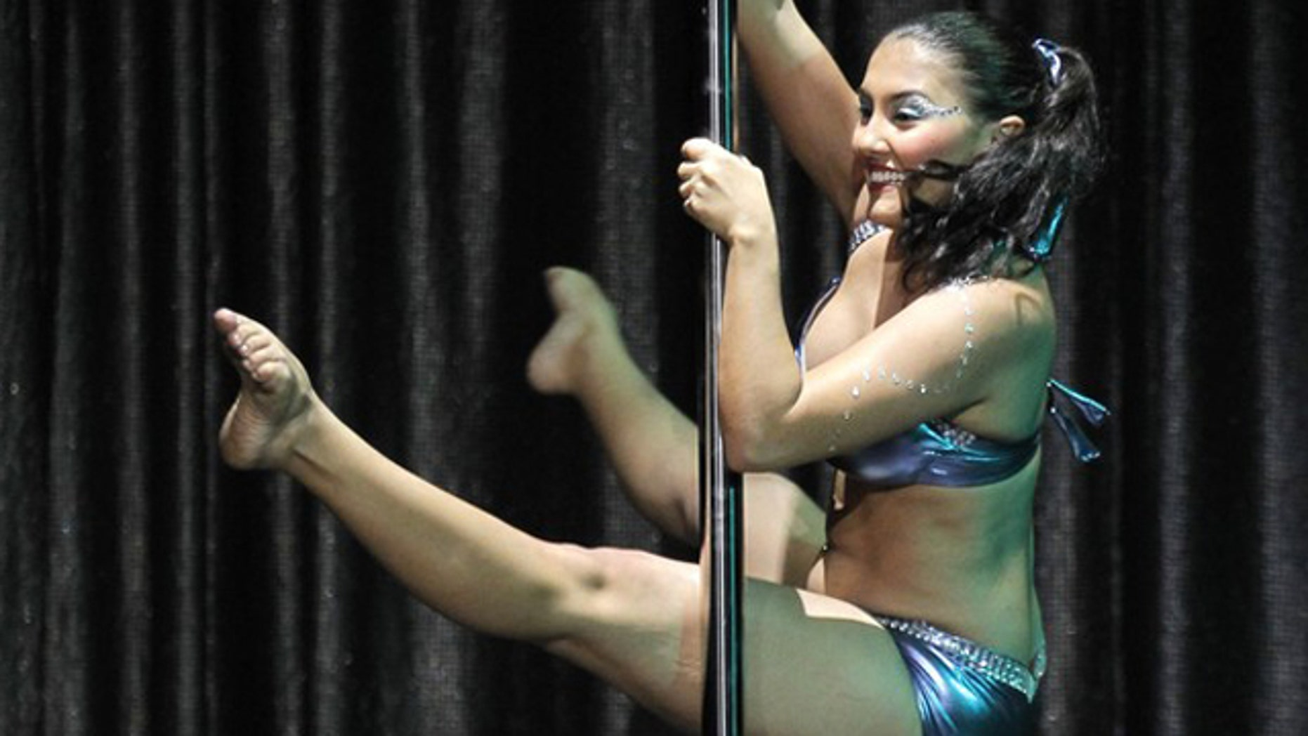 Nov. 6, 2010: Professional pole dancer Regina Mutai of Brazil performs her routine in the Miss Pole Dancing Argentina and Sudamerica 2010 competition in Buenos Aires.