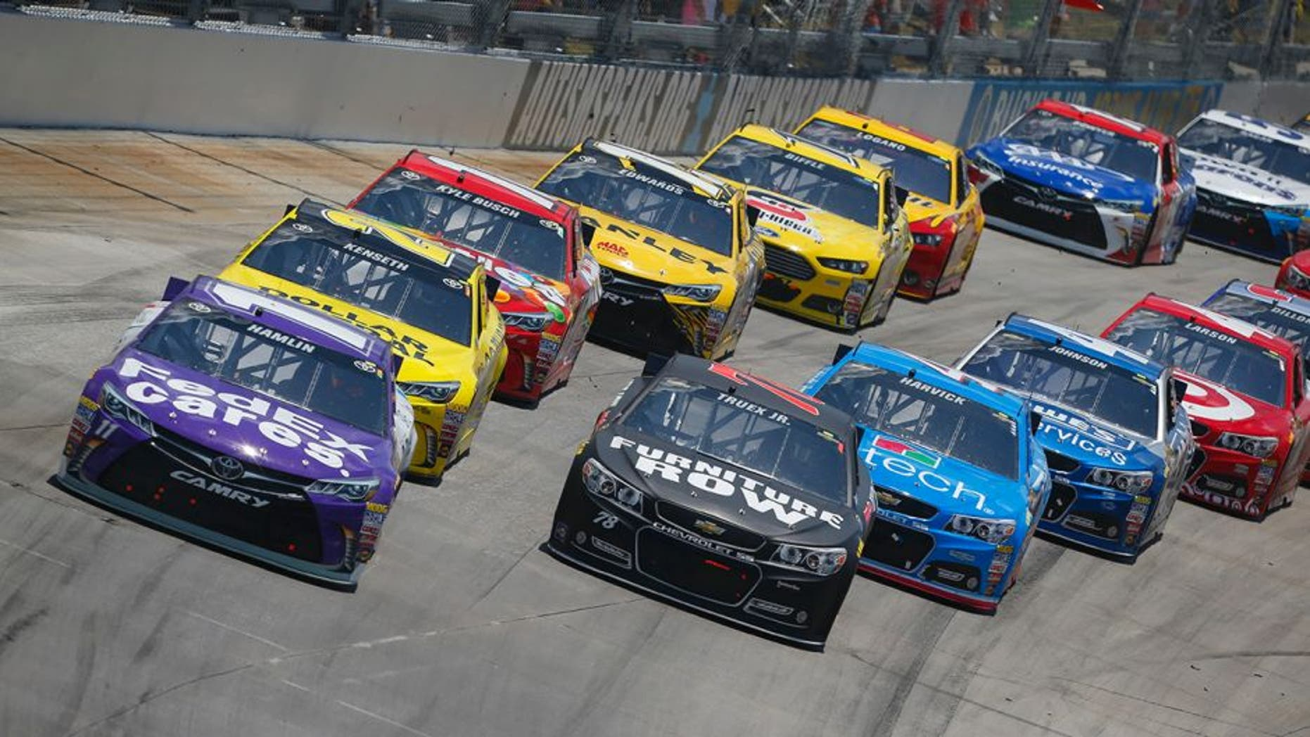 Denny Hamlin, driver of the #11 FedEx Cares Toyota, leads a pack of cars during the NASCAR Sprint Cup Series FedEx 400 Benefiting Autism Speaks at Dover International Speedway on May 31, 2015 in Dover, Delaware.