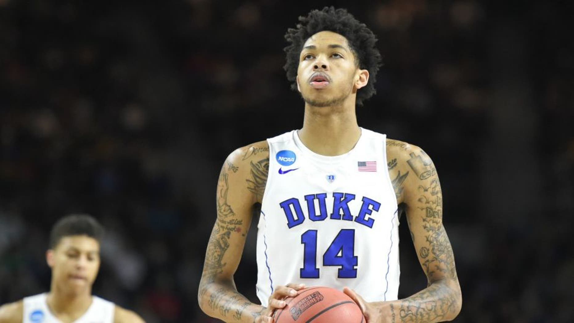 PROVIDENCE, RI - MARCH 19: Brandon Ingram #14 of the Duke Blue Devils takes a foul shot during a first round NCAA College Basketball Tournament game against the Yale Bulldogs at Dunkin' Donuts Center on March 19, 2016 in Providence, Rhode Island. The Blue Devils won 71-64. (Photo by Mitchell Layton/Getty Images)