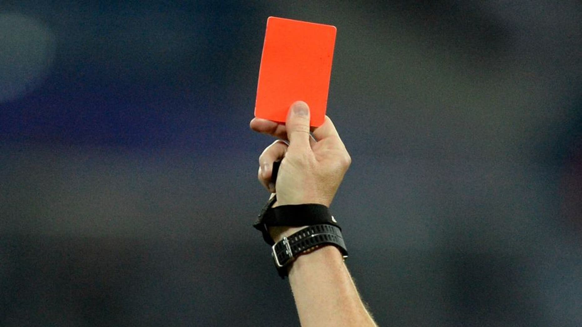 The French referee Ruddy Buquet gives a red card to Monacos Ivorian forward Lacina Traore (L) during the French L1 football match between Olympique Lyonnais (OL) and Association sportive de Monaco (ASM) at the Parc de l'Olympique Lyonnais in Decines-Charpieu, central eastern France, on May 7, 2016. / AFP / ROMAIN LAFABREGUE (Photo credit should read ROMAIN LAFABREGUE/AFP/Getty Images)