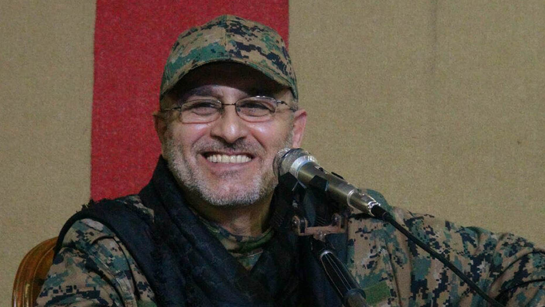 This undated handout image released on Friday, May 13, 2016, by Hezbollah Media Department, shows slain top military commander Mustafa Badreddine smiling during a meeting.
