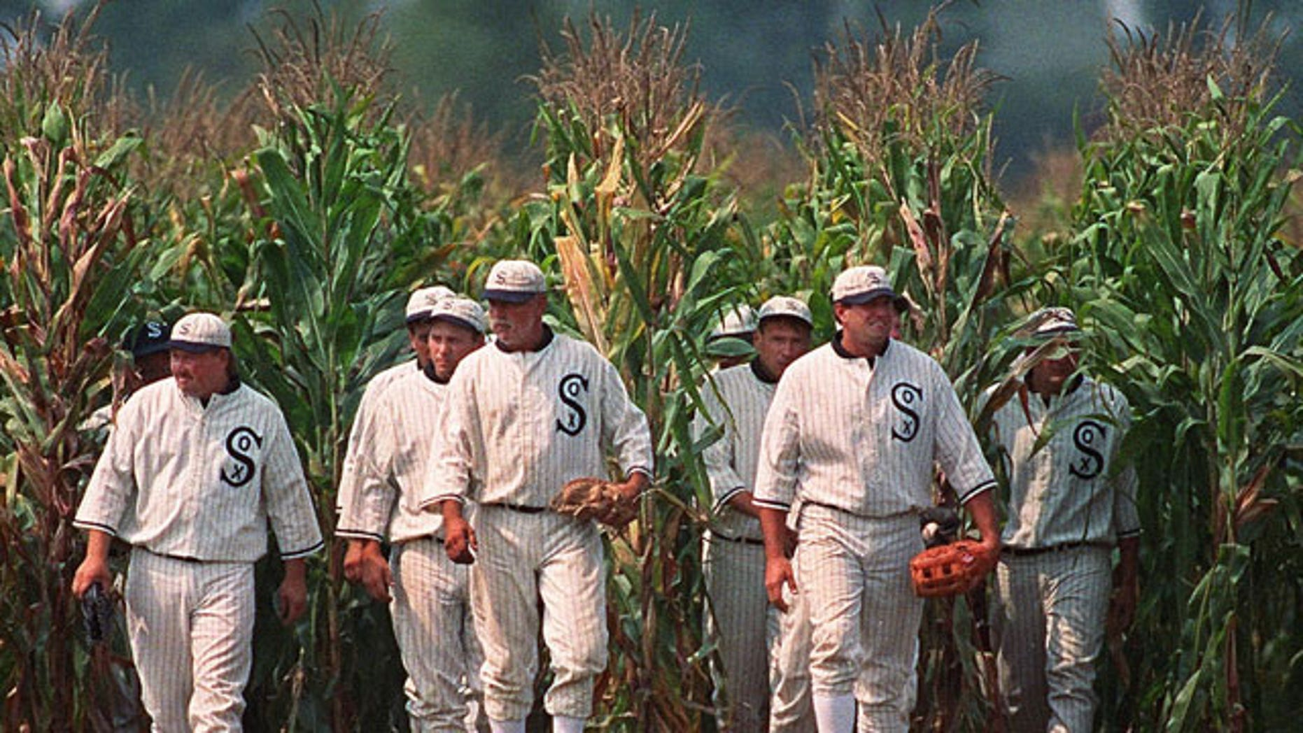 "In this June 22, 1997, file photo, Ghost Players emerge from the cornfield at the ""Field of Dreams"" movie site in Dyersville, Iowa."