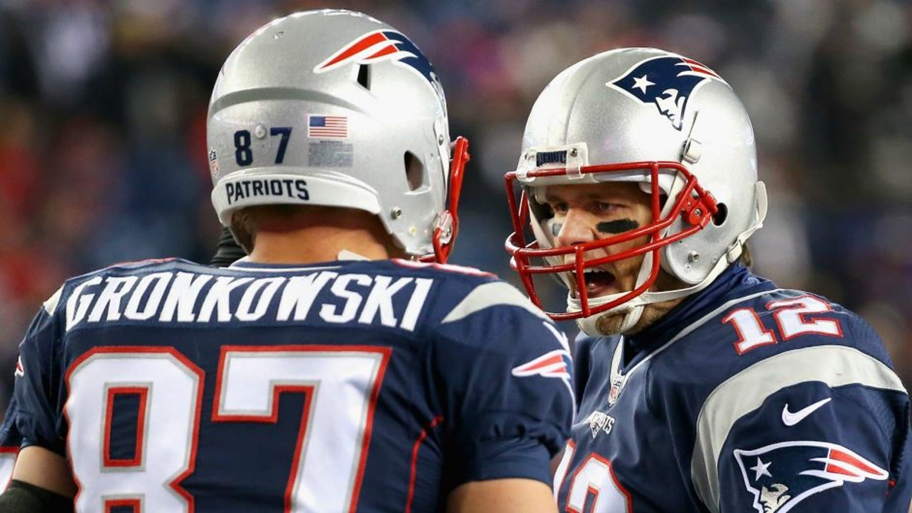 > of the New England Patriots of the Buffalo Bills at Gillette Stadium on November 23, 2015 in Foxboro, Massachusetts.,FOXBORO, MA - NOVEMBER 23: Tom Brady #12 of the New England Patriots reacts with Rob Gronkowski #87 before a game against the Buffalo Bills at Gillette Stadium on November 23, 2015 in Foxboro, Massachusetts. (Photo by Jim Rogash/Getty Images)