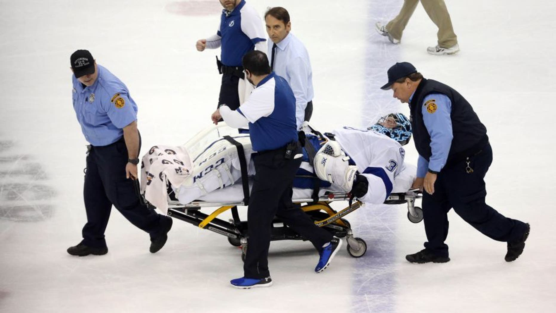 May 13, 2016; Pittsburgh, PA, USA; Tampa Bay Lightning goalie Ben Bishop (30) is taken from the ice on a stretcher after suffering an apparent injury against the Pittsburgh Penguins during the first period in game one of the Eastern Conference Final of the 2016 Stanley Cup Playoffs at the CONSOL Energy Center. Mandatory Credit: Charles LeClaire-USA TODAY Sports