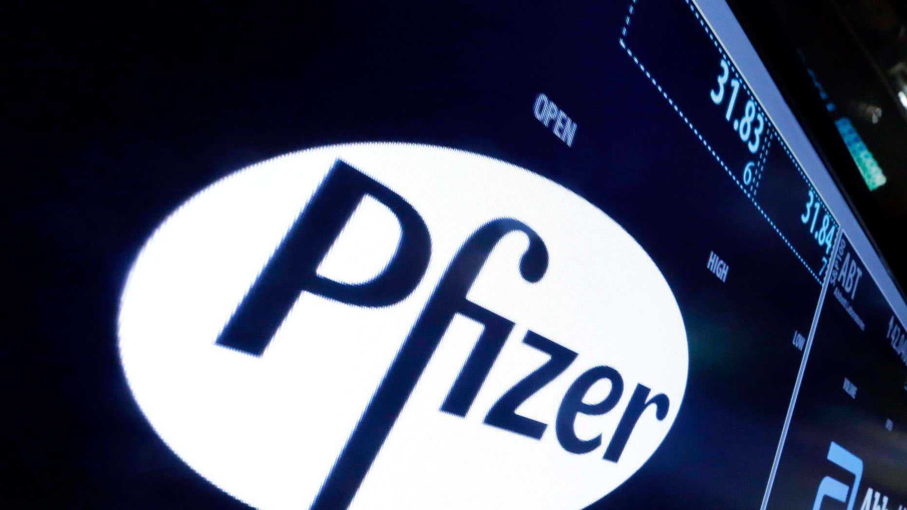 File-This April 6, 2016, file photo shows the Pfizer logo appearing on a screen above its trading post on the floor of the New York Stock Exchange.