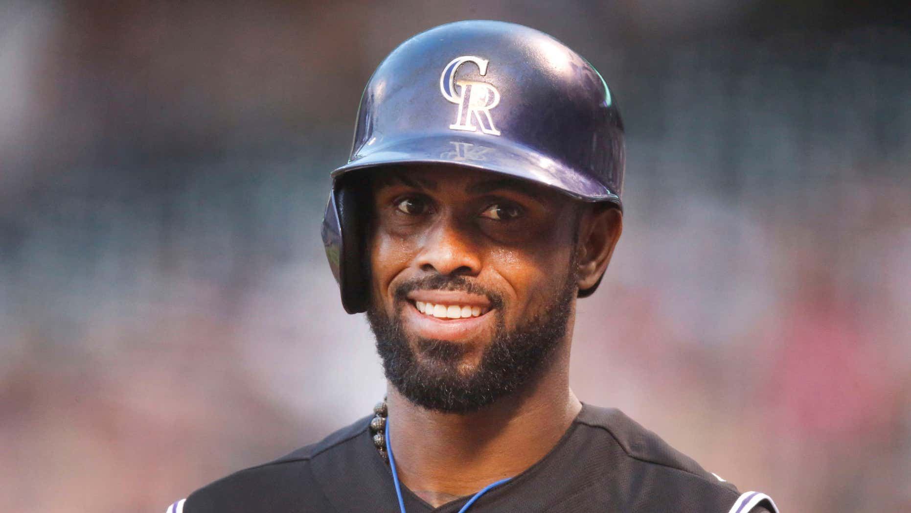 FILE - In this Aug. 21, 2015, file photo, Colorado Rockies shortstop Jose Reyes is seen in the first inning of a baseball game in Denver.