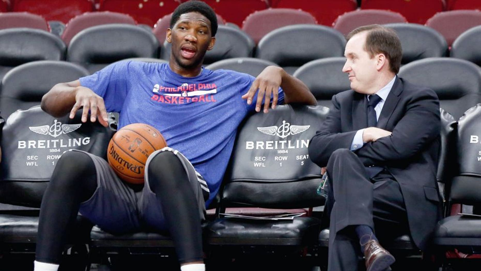 Dec 15, 2014; Philadelphia, PA, USA; Injured Philadelphia 76ers center Joel Embiid (left) talks with general manager and president Sam Hinkie (right) before a game against the Boston Celtics at Wells Fargo Center. Mandatory Credit: Bill Streicher-USA TODAY Sports