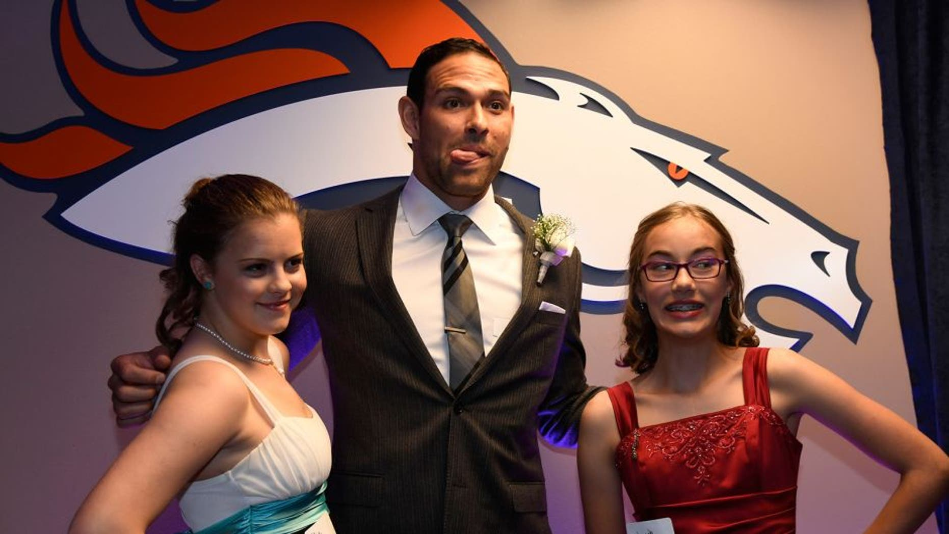 DENVER, CO - MAY 13: Denver Broncos quarterback Mark Sanchez poses for a photo during a Night of Champions prom. Teens got their makeup, hair and nails done before prom night May 13, 2016 at Sports Authority Field at Mile High. Some of the teens missed their own prom due to illness and just couldn't attend. Childrens Hospital hosted the Night of Champions gala. (Photo By John Leyba/The Denver Post via Getty Images)