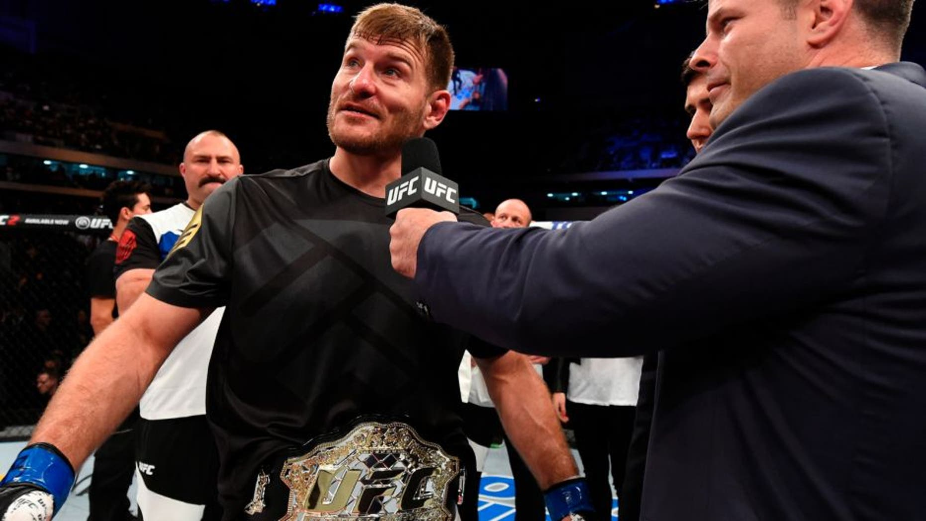CURITIBA, BRAZIL - MAY 14: (L-R) Stipe Miocic is interviewed by UFC play-by-play broadcaster Brian Stann after defeating Fabricio Werdum of Brazil by KO in their UFC heavyweight championship bout during the UFC 198 event at Arena da Baixada stadium on May 14, 2016 in Curitiba, Parana, Brazil. (Photo by Josh Hedges/Zuffa LLC/Zuffa LLC via Getty Images)