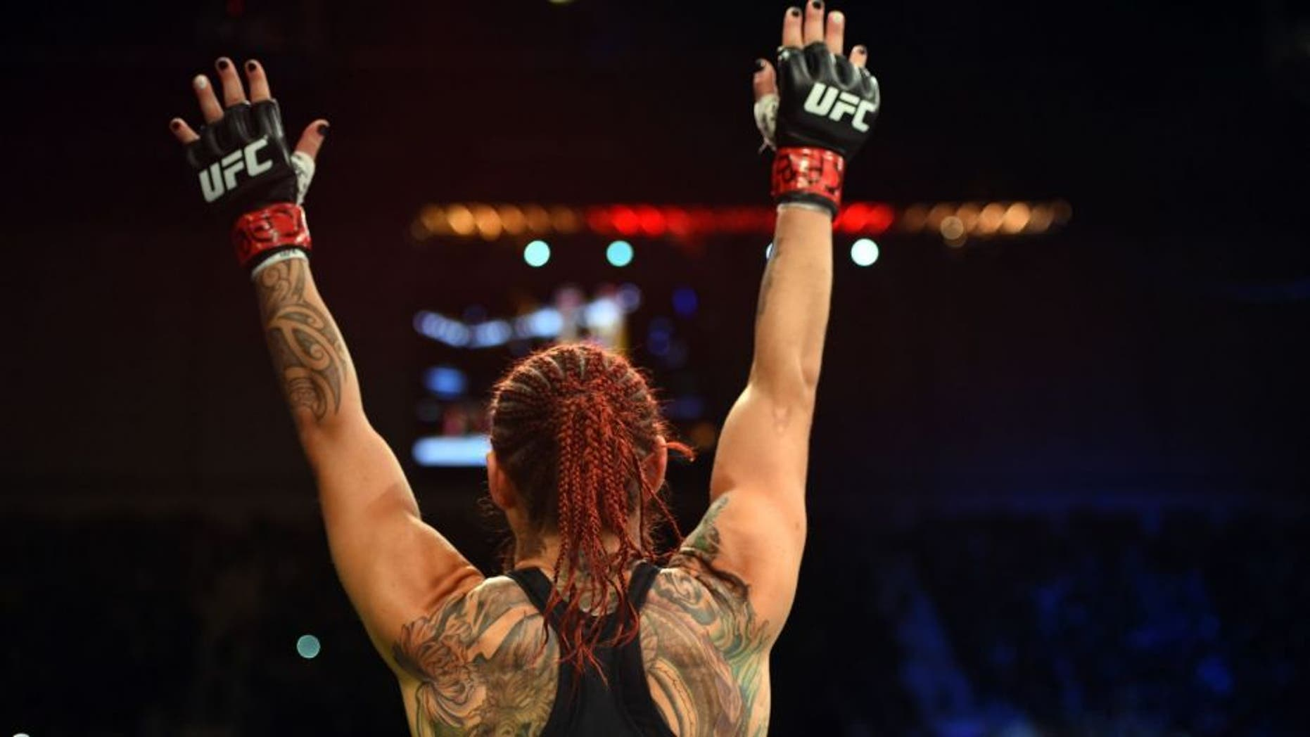 CURITIBA, BRAZIL - MAY 14: Cristiane 'Cyborg' Justino of Brazil celebrates after defeating Leslie Smith in their women's catchweight bout during the UFC 198 event at Arena da Baixada stadium on May 14, 2016 in Curitiba, Parana, Brazil. (Photo by Josh Hedges/Zuffa LLC/Zuffa LLC via Getty Images)