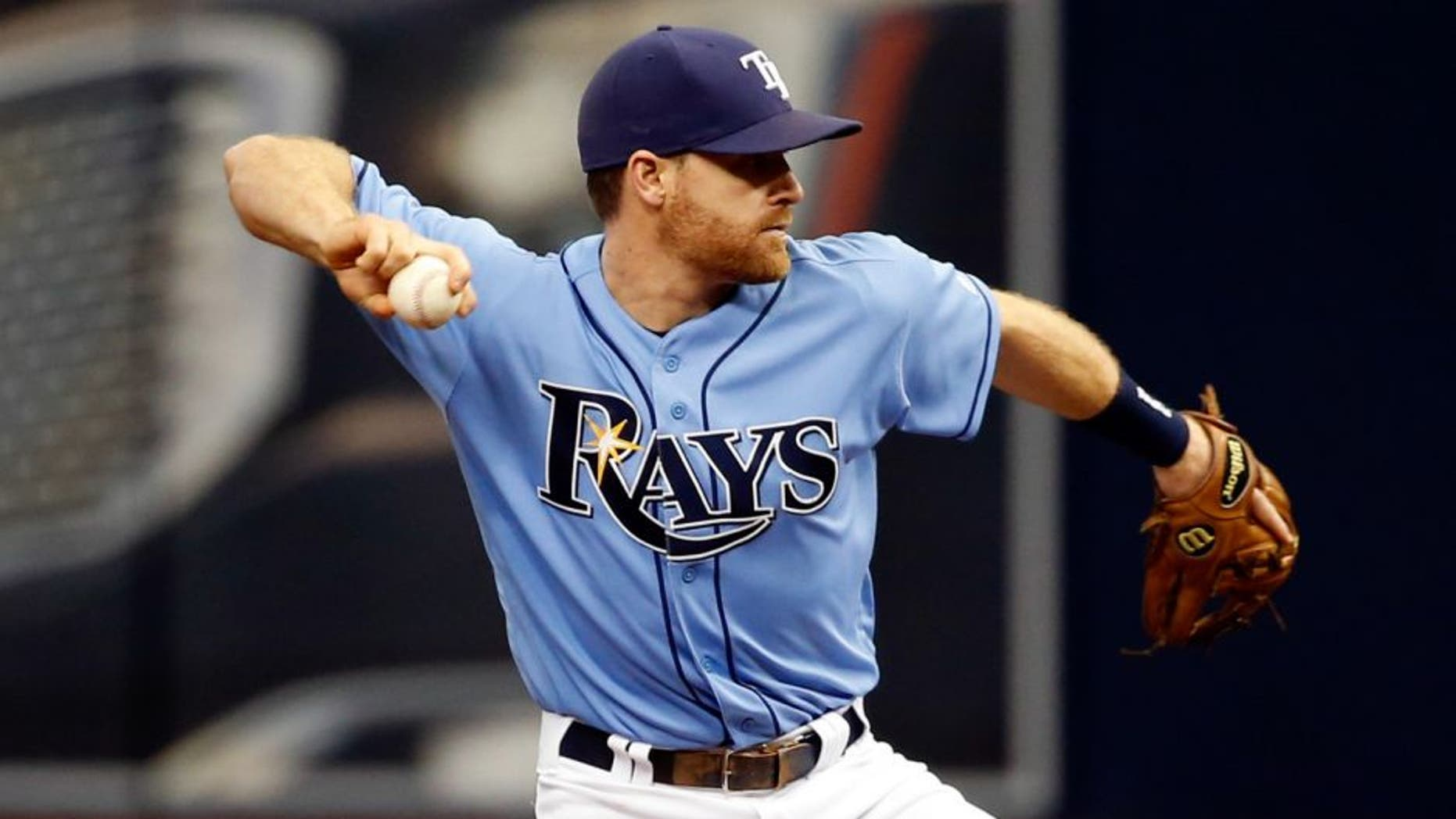 May 1, 2016; St. Petersburg, FL, USA; Tampa Bay Rays second baseman Logan Forsythe (11) throws the ball to first base for a double play against the Toronto Blue Jays at Tropicana Field. Mandatory Credit: Kim Klement-USA TODAY Sports