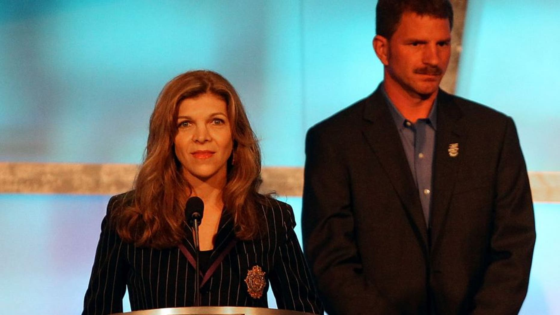CHARLOTTE, NC - MAY 23: (L-R) Teresa Earnhardt speaks as Kerry Earnhardt, Kelley Earnhardt Elledge, Dale Earnhardt Jr. and Taylor Earnhardt stand on stage as Dale Earnhardt Sr. gets inducted into the 2010 NASCAR Hall of Fame Induction Ceremony at the Charlotte Convention Center on May 23, 2010 in Charlotte, North Carolina. (Photo by Streeter Lecka/Getty Images)