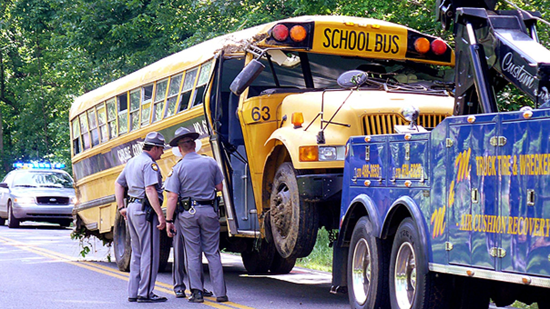 May 16: Kentucky State Police troopers gather around a Carlisle County school bus that crashed along U.S. 62 near the intersection of Ky. 307 in Carlisle County near the community of Cunningham, Ky.