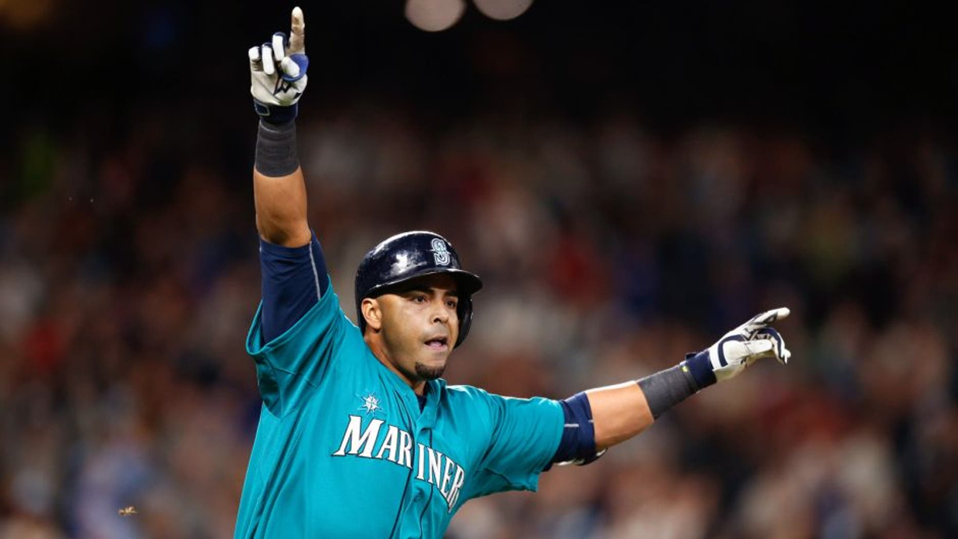 SEATTLE, WA - MAY 15: Nelson Cruz #23 of the Seattle Mariners celebrates after hitting a walkoff single to defeat the Boston Red Sox 2-1 at Safeco Field on May 15, 2015 in Seattle, Washington. (Photo by Otto Greule Jr/Getty Images)