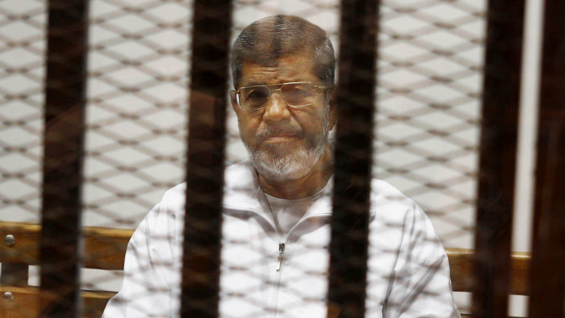 May 8, 2014: Egypt's ousted Islamist President Mohammed Morsi sits in a defendant cage in the Police Academy courthouse in Cairo, Egypt.