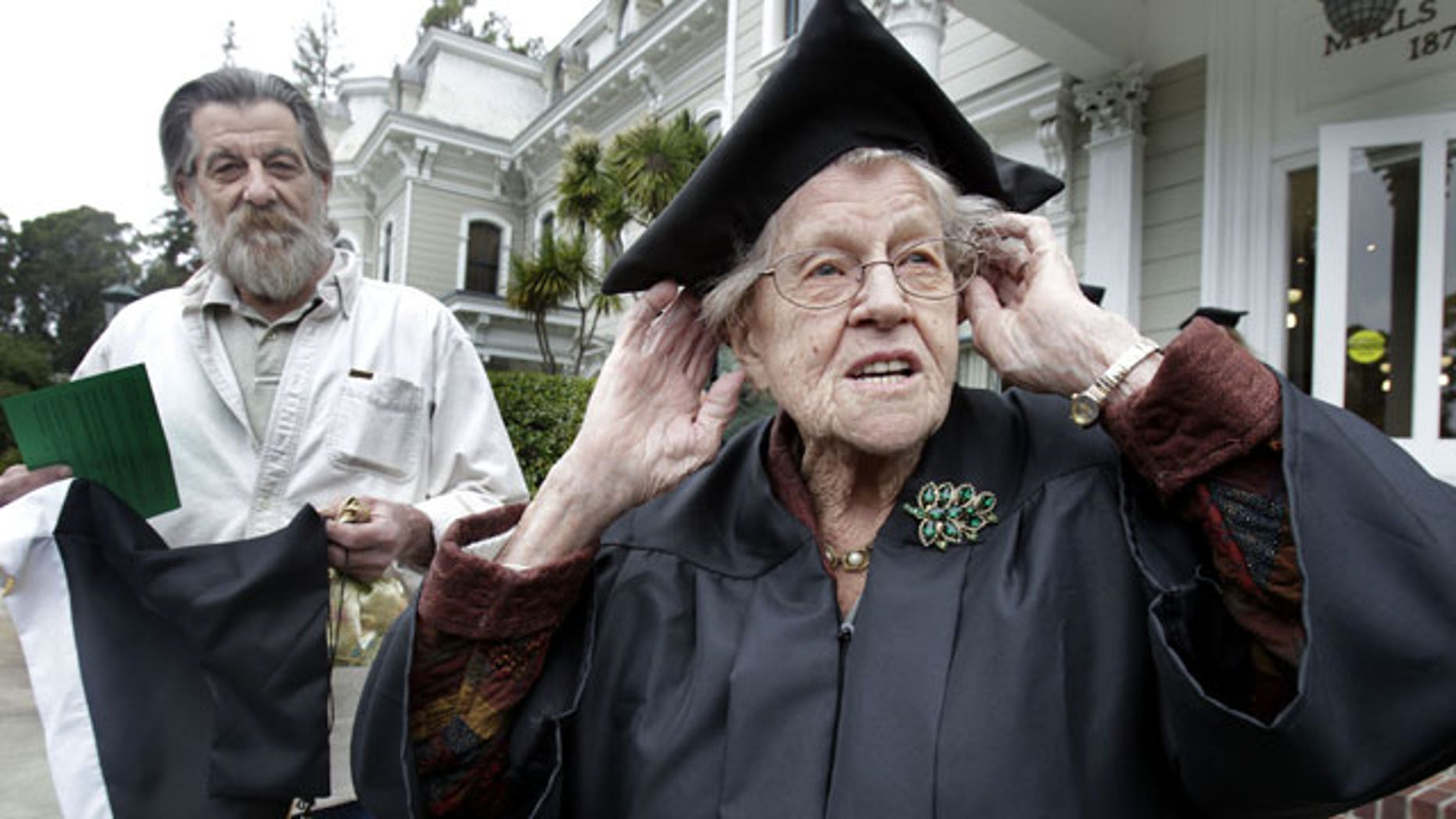 May 15: Hazel Soares, 94, right, gets ready before the start of commencement exercises at Mills College, as her son Matthew Soares, 59, looks on in Oakland, Calif.