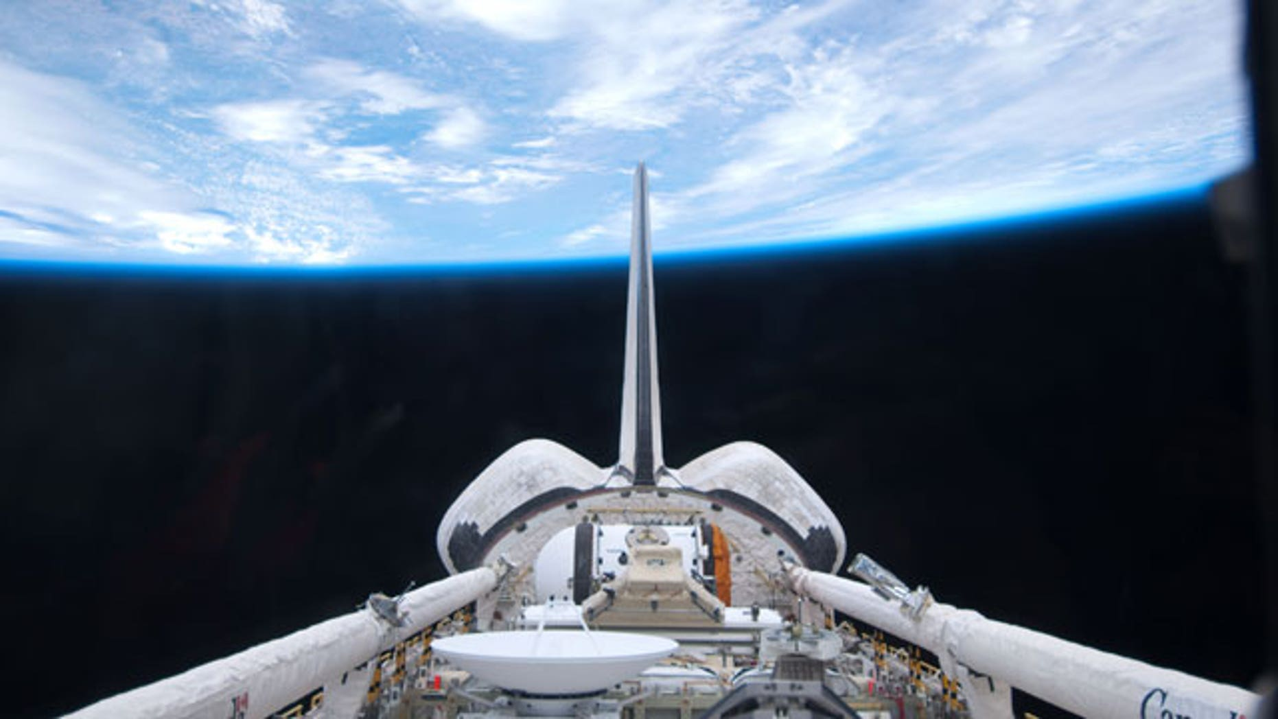 May 15: In this image provided by NASA, space shuttle Atlantis' cargo bay and its vertical stabilizer intersecting Earth's horizon was provided on by one of the six STS-132 crew members.
