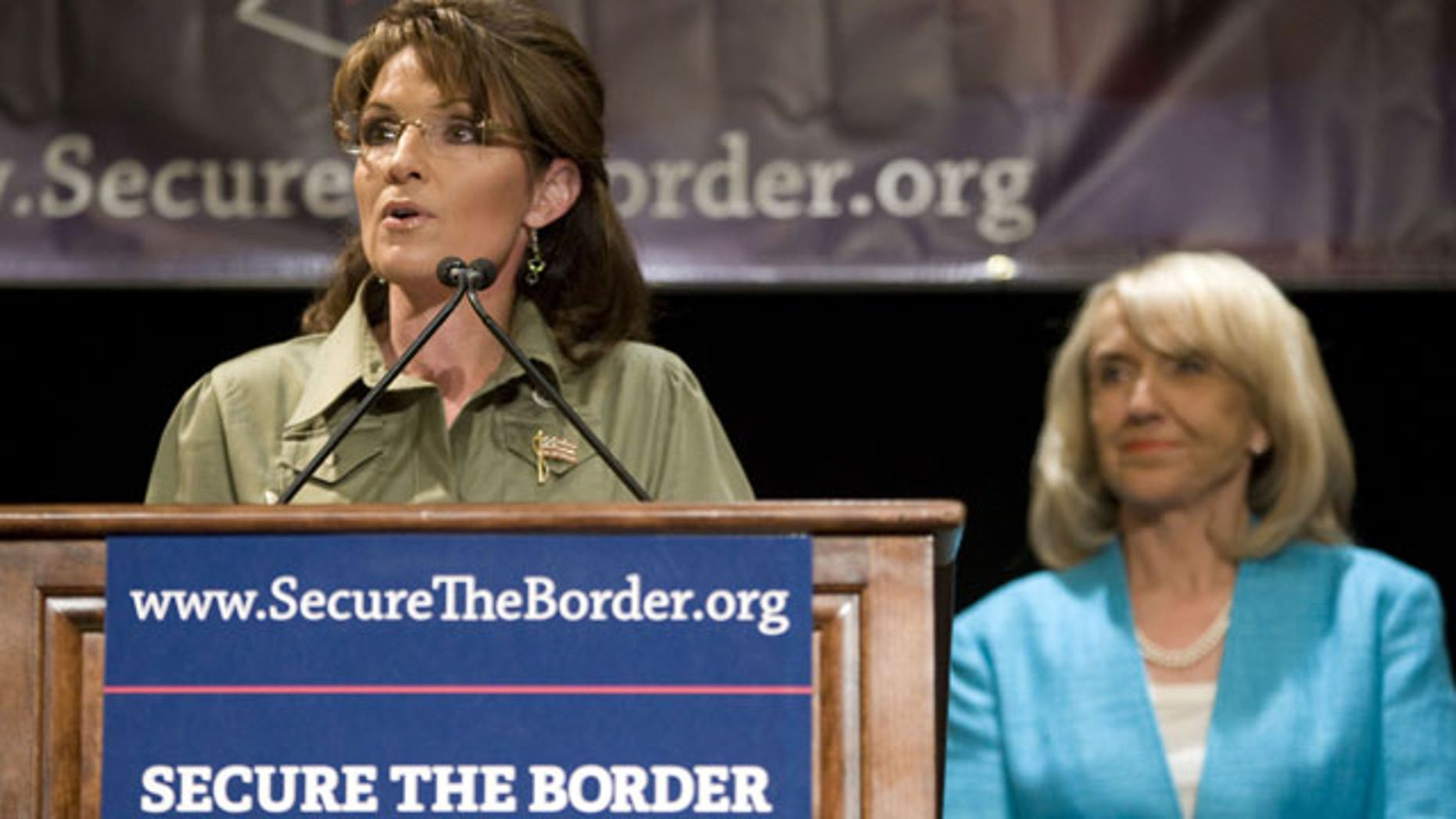 May 15: Former Alaska Governor Sarah Palin, left, speaks as Arizona Gov. Jan Brewer looks on at a news conference about border security at the JW Marriott Desert Ridge in Phoenix.