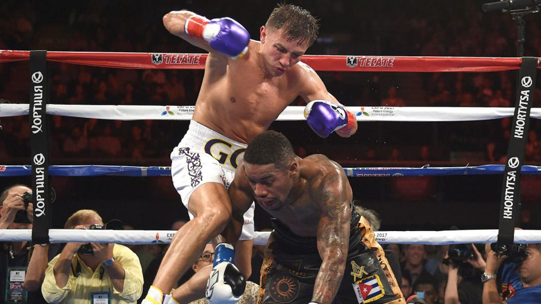 Boxer Gennady Golovkin from Kazakhstan knocks out Willie Monroe of the US in the sixth round during their Middleweight World Championship bout at the Forum Arena in Los Angeles, California on May 16, 2015. AFP PHOTO / MARK RALSTON (Photo credit should read MARK RALSTON/AFP/Getty Images)