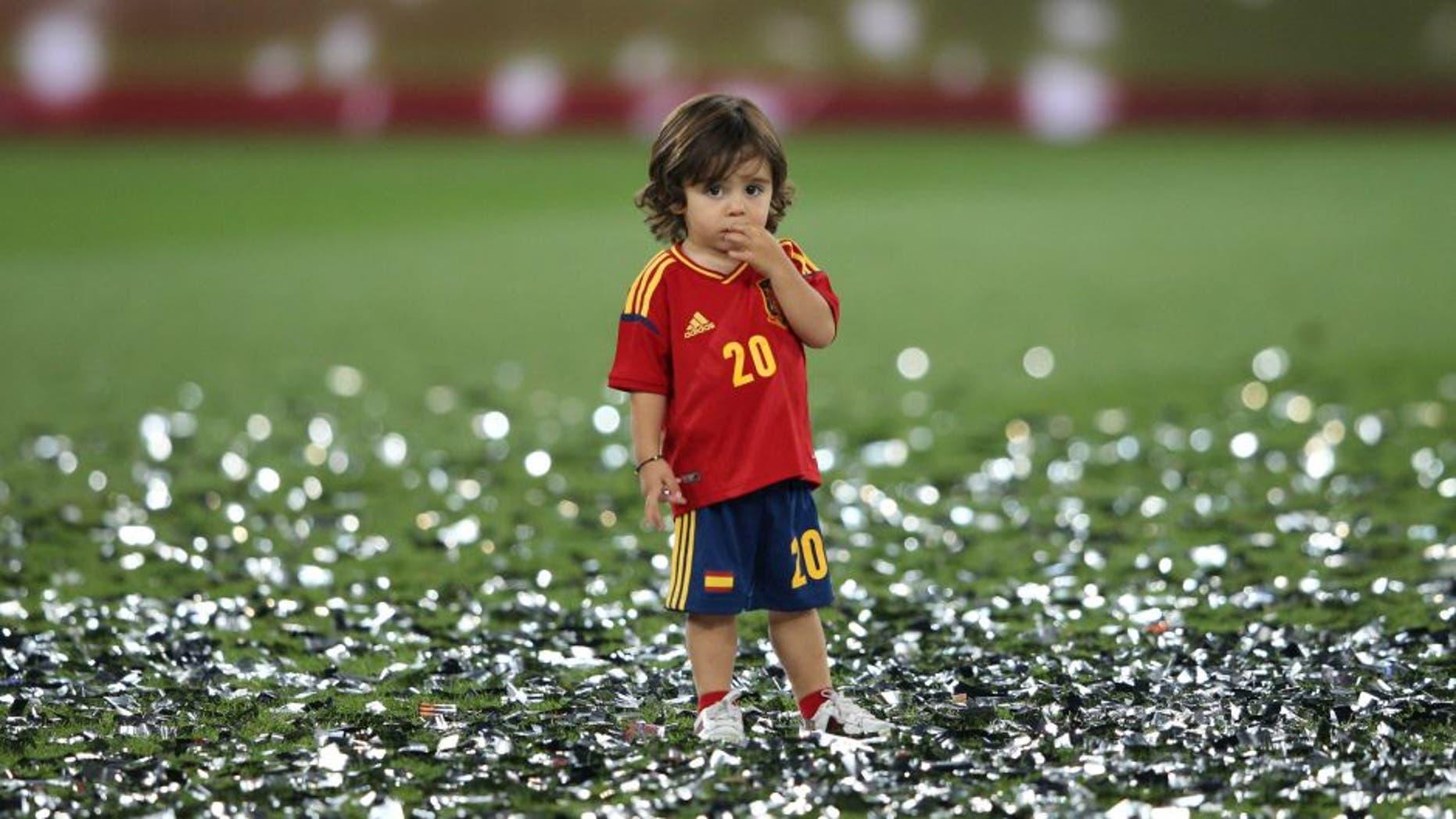 Football - Spain v Italy - UEFA EURO 2012 Final - Olympic Stadium, Kiev, Ukraine - 1/7/12 Spain's Santi Cazorla's son celebrates after the match Mandatory Credit: Action Images / Carl Recine Livepic