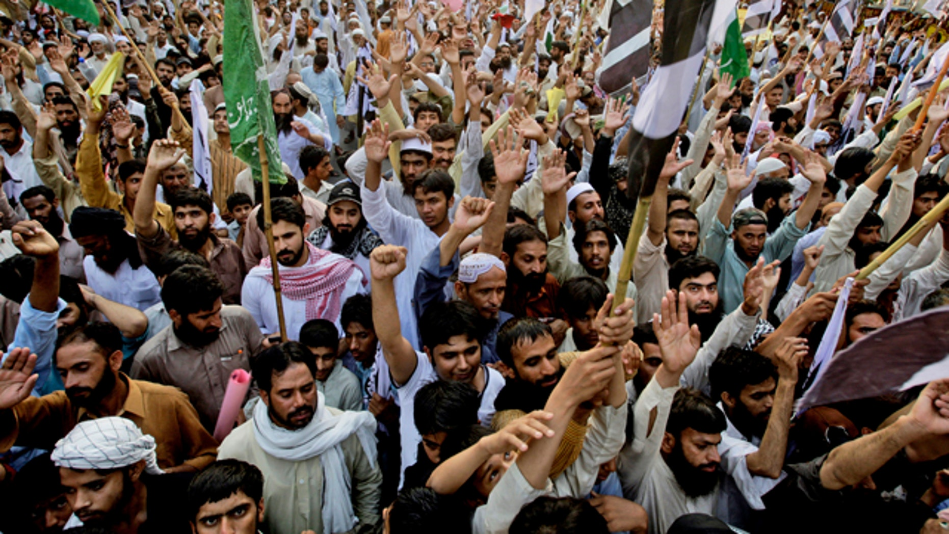 Supporters of Pakistani religious group Jamaat-ud-Dawa, rally to condemn the United States for the killing of Al Qaeda leader Usama bin Laden, in Lahore, Pakistan.