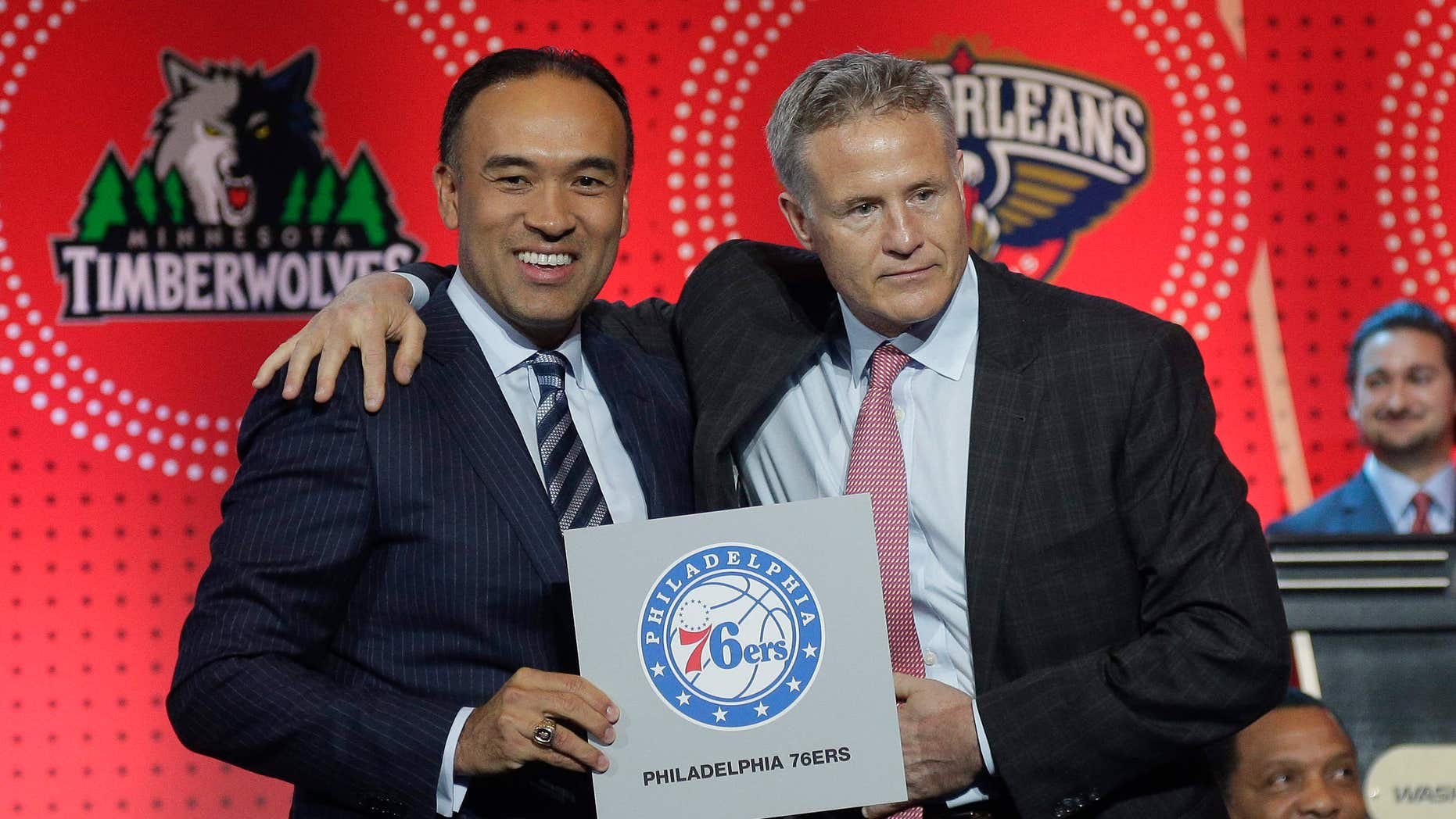 NBA deputy commissioner Mark Tatum, left, poses for a photo with Philadelphia 76ers head coach Brett Brown during the NBA basketball draft lottery, Tuesday, May 17, 2016, in New York.