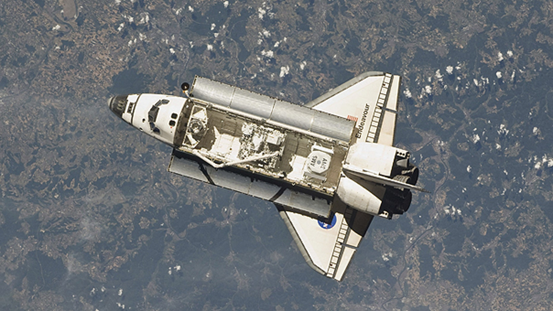 May 18: This image provided by NASA taken by one of the Expedition 27 crew members aboard the International Space Station shows the space shuttle Endeavour as the two spacecraft made their relative approach.