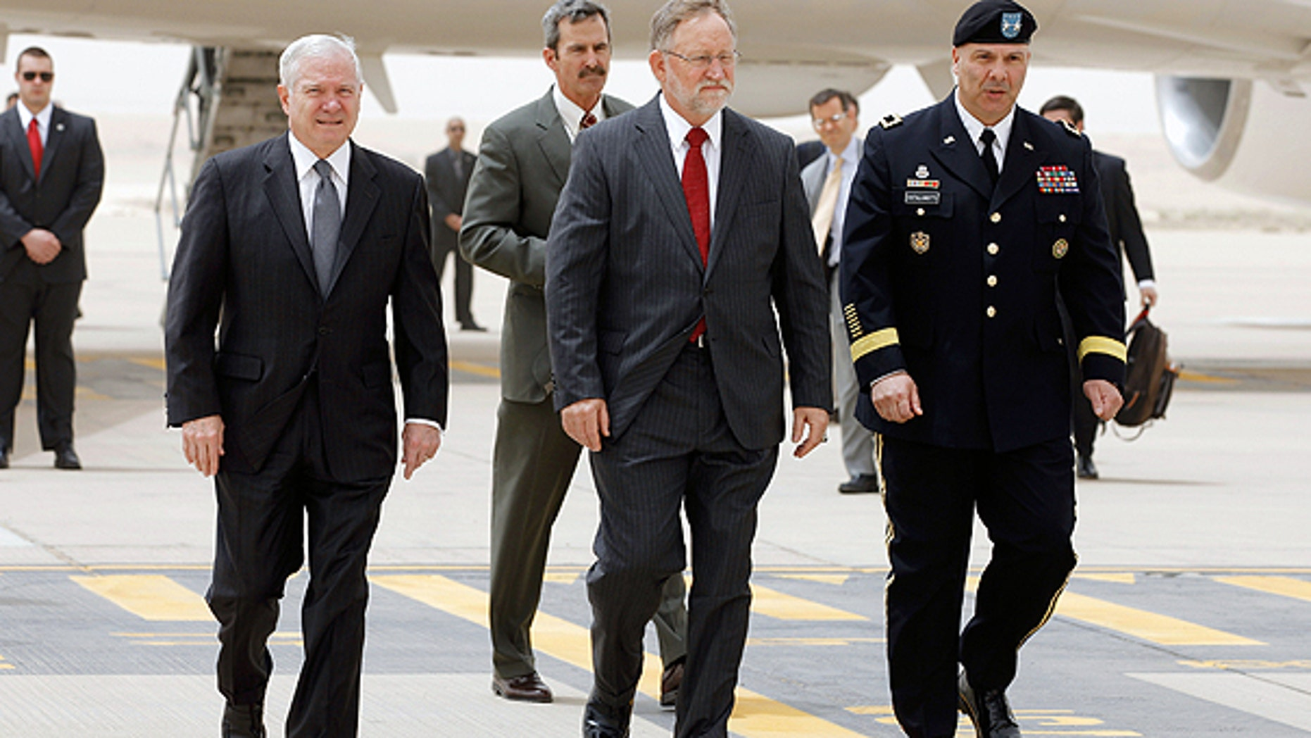 April 6: Defense Secretary Robert Gates, left, U.S. Ambassador to Saudi Arabia James Smith, center, and Maj. Gen. Robert Catalanotti, right, walk across the tarmac in Riyadh, Saudi Arabia.